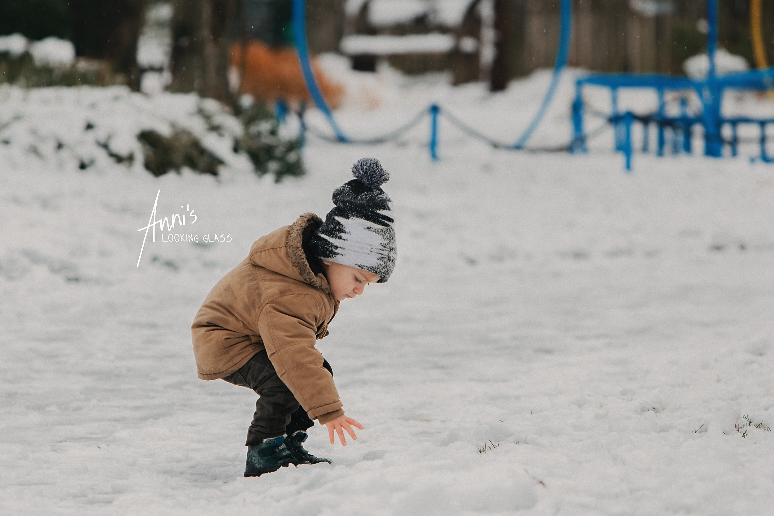 A young boy playing in the snow
