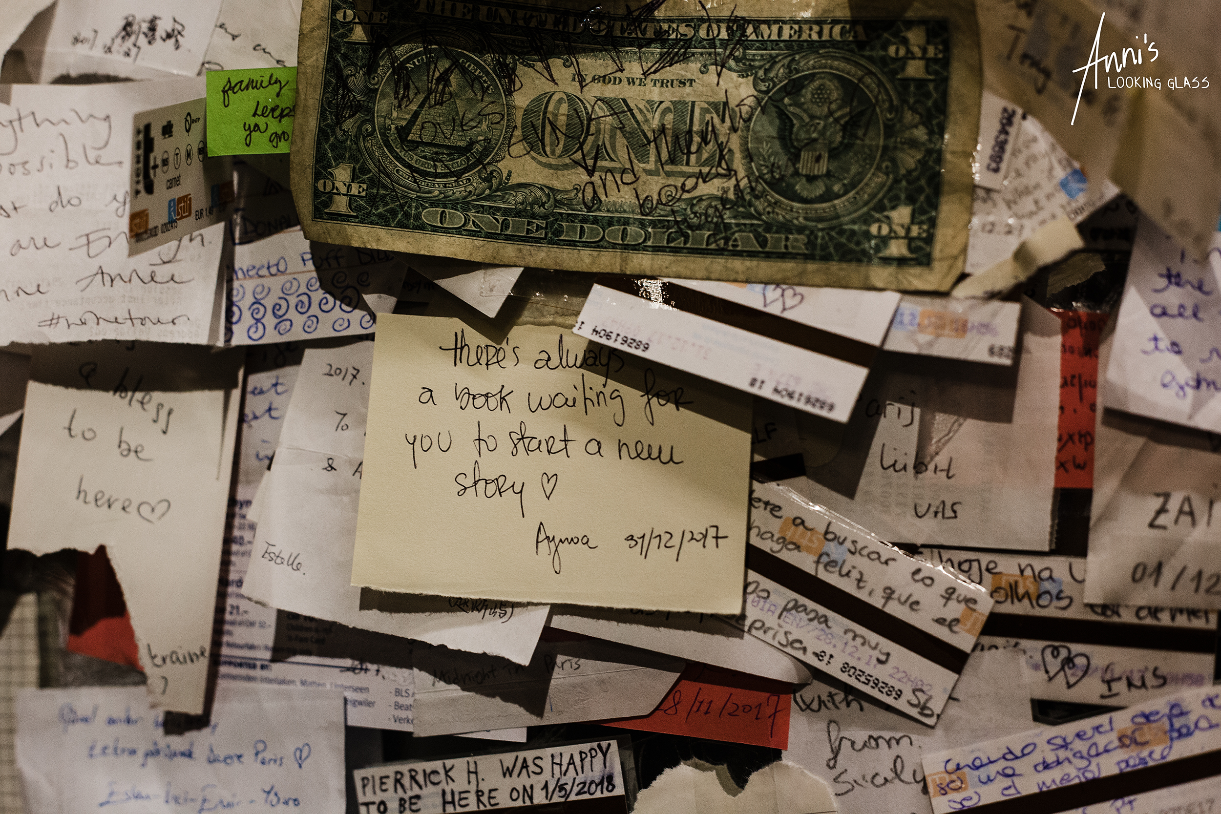 A wall with many messages left by visitors of the Shakespeare and Company bookstore in Paris, France