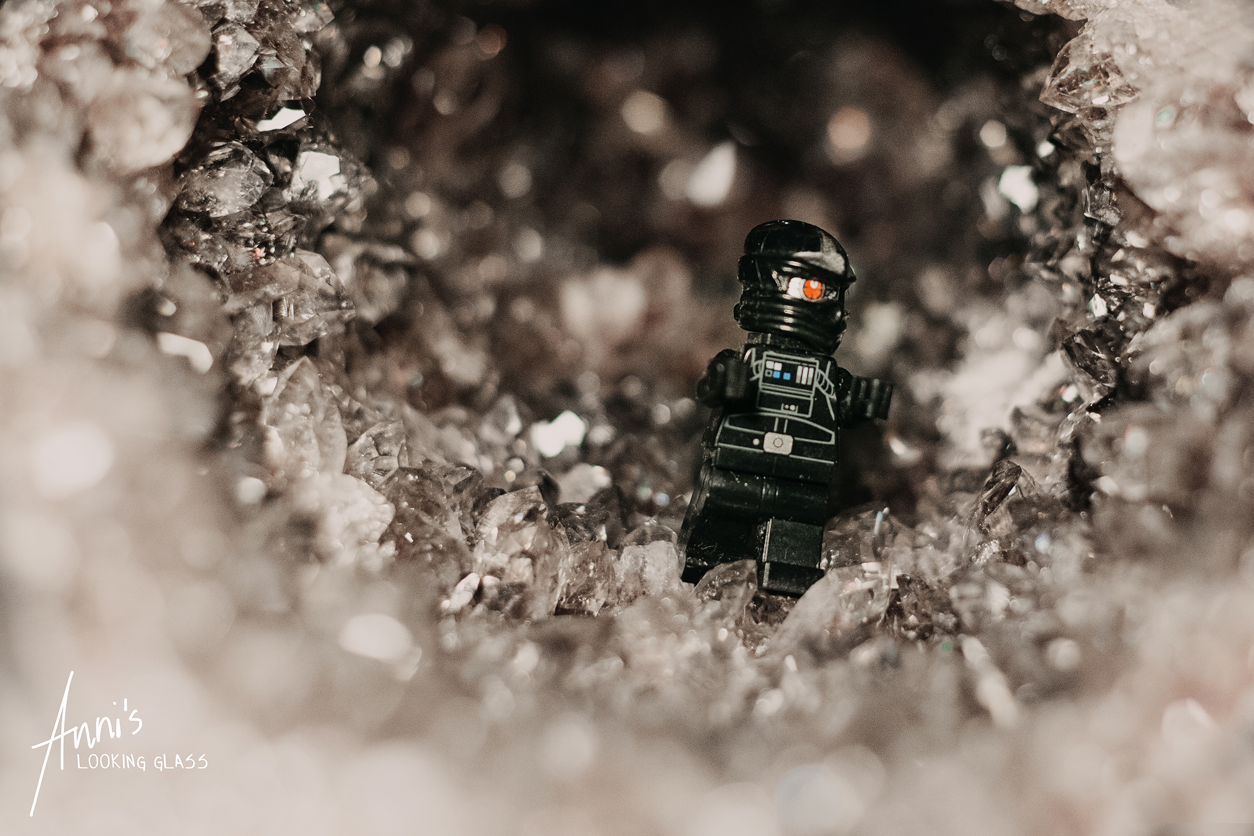 A Lego figure photographed inside a big crystal