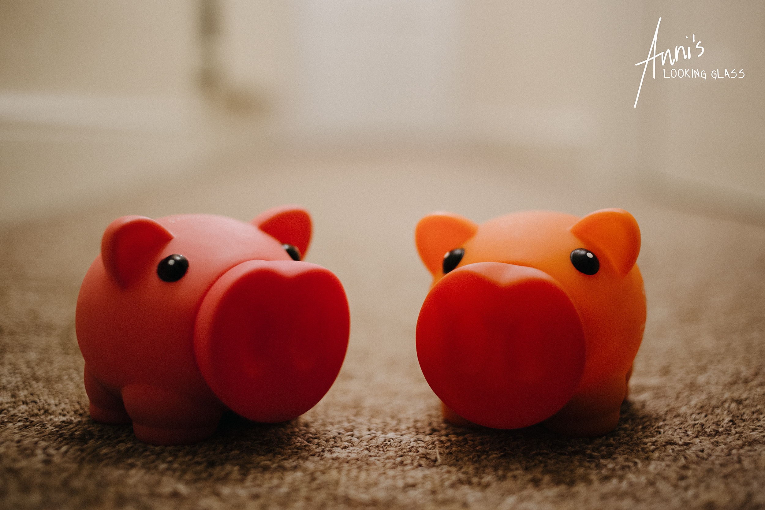 A pink and an orange piggy bank from Love Loughborough