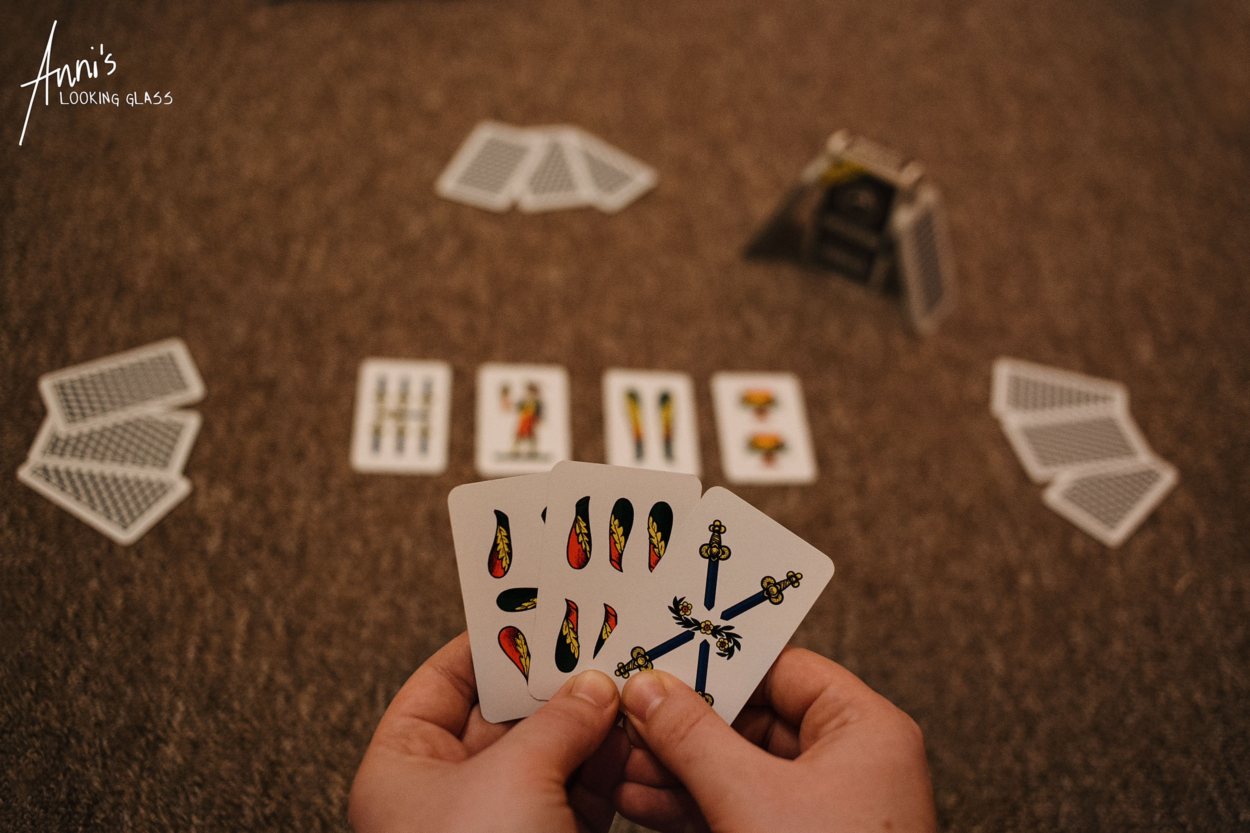 A deck of the Italian card game Scopa is set up for four players