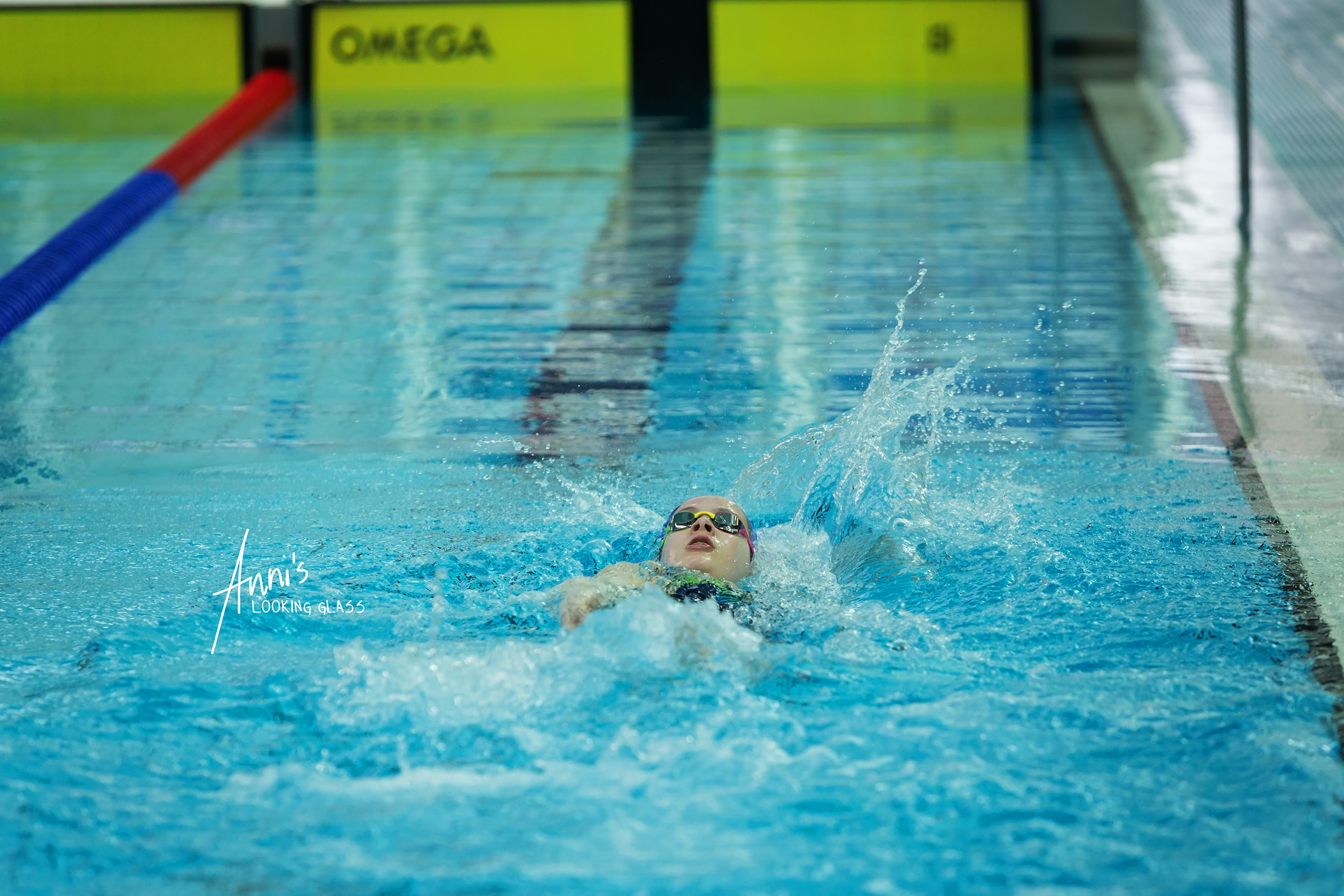 Loughborough Photographer: A girl competing in a swimming race at Loughborough University's pool. 24th March 2018