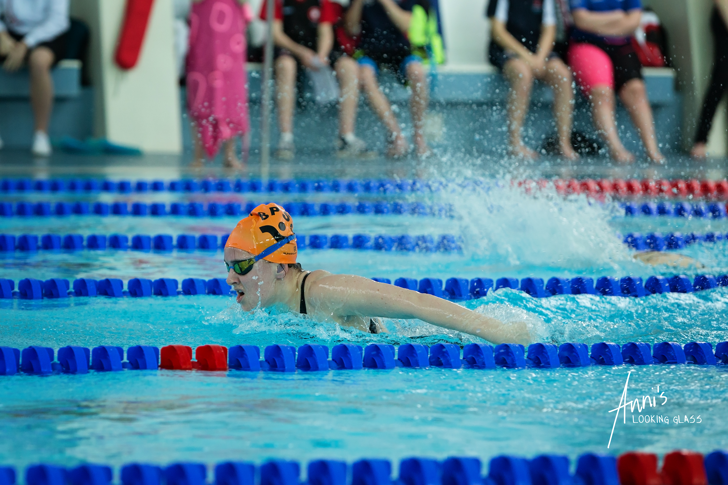 Loughborough Photographer: A young woman in a swimming race at Loughborough University's pool. 24th March 2018