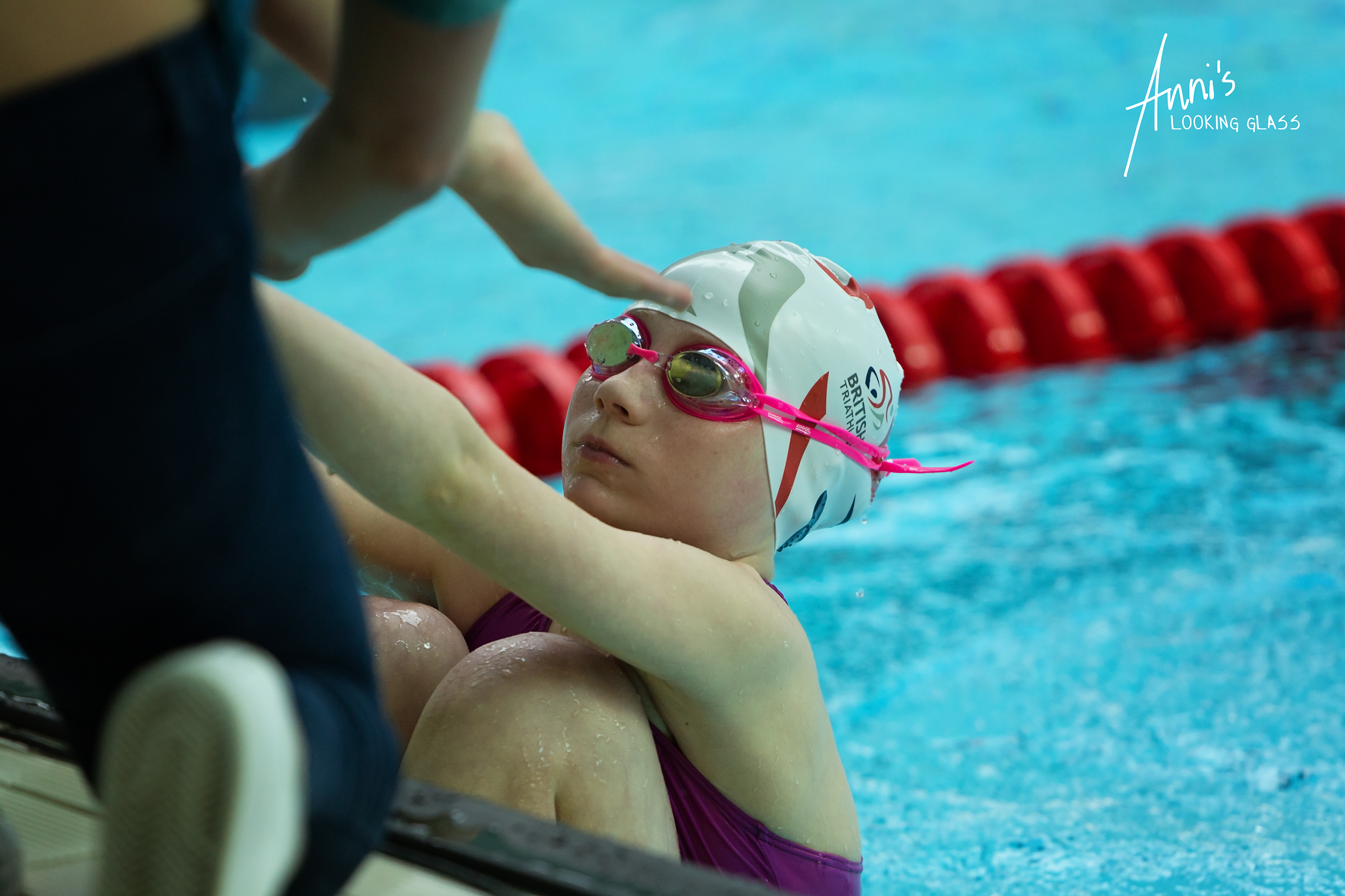 Loughborough Photographer: A young girl in a pink and white swimming outfit waiting for the start signal to her race at Loughborough University's pool. 24th March 2018