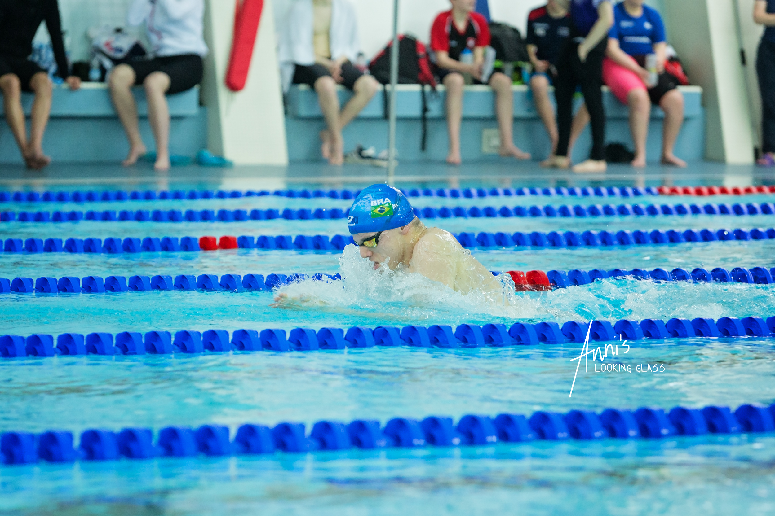 Loughborough Photographer: A young man in a blue ap with the Brazilian flag competing in a swimming race at Loughborough University's pool. 24th March 2018