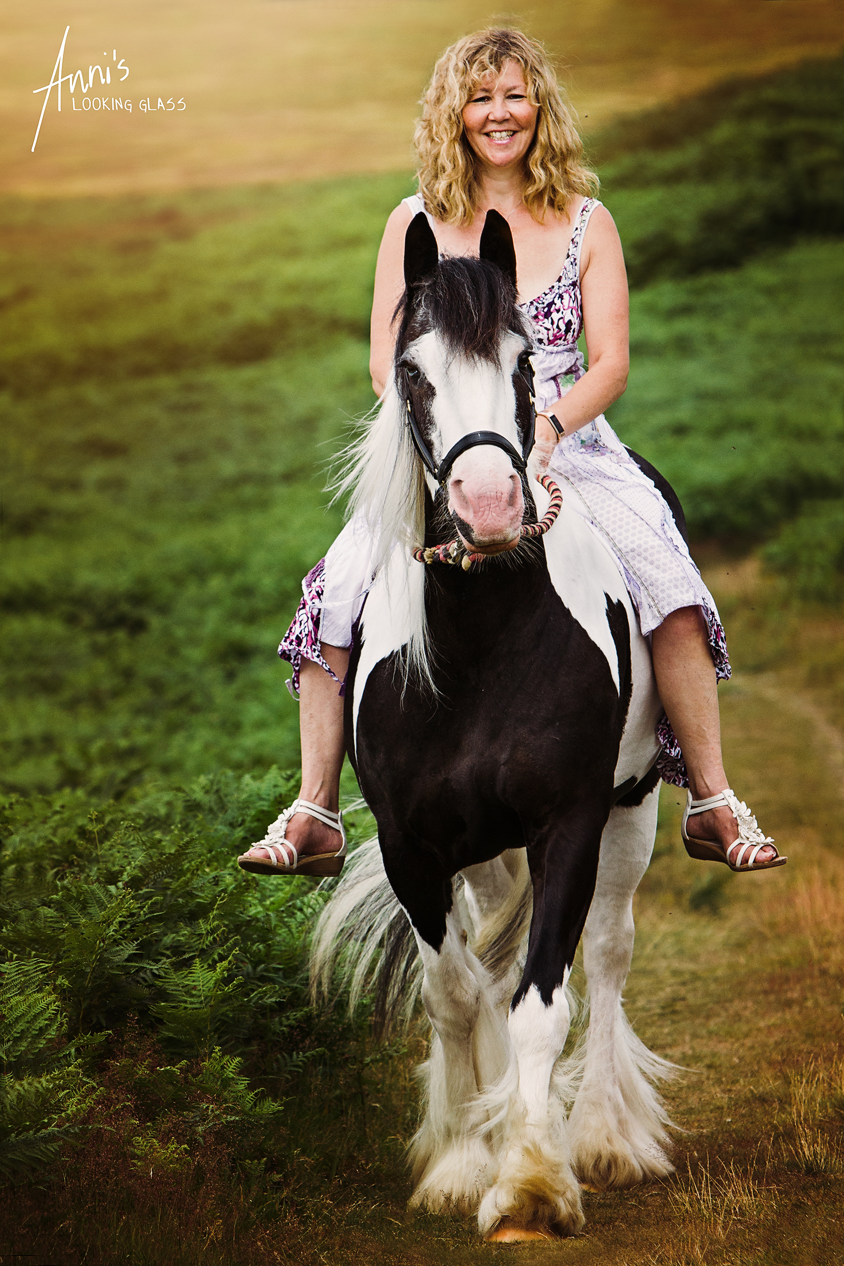 Bradgate Park, Newton Linford, Leicestershire: A blonde woman riding her black and white gypsy cob bareback. 2nd July, 2017