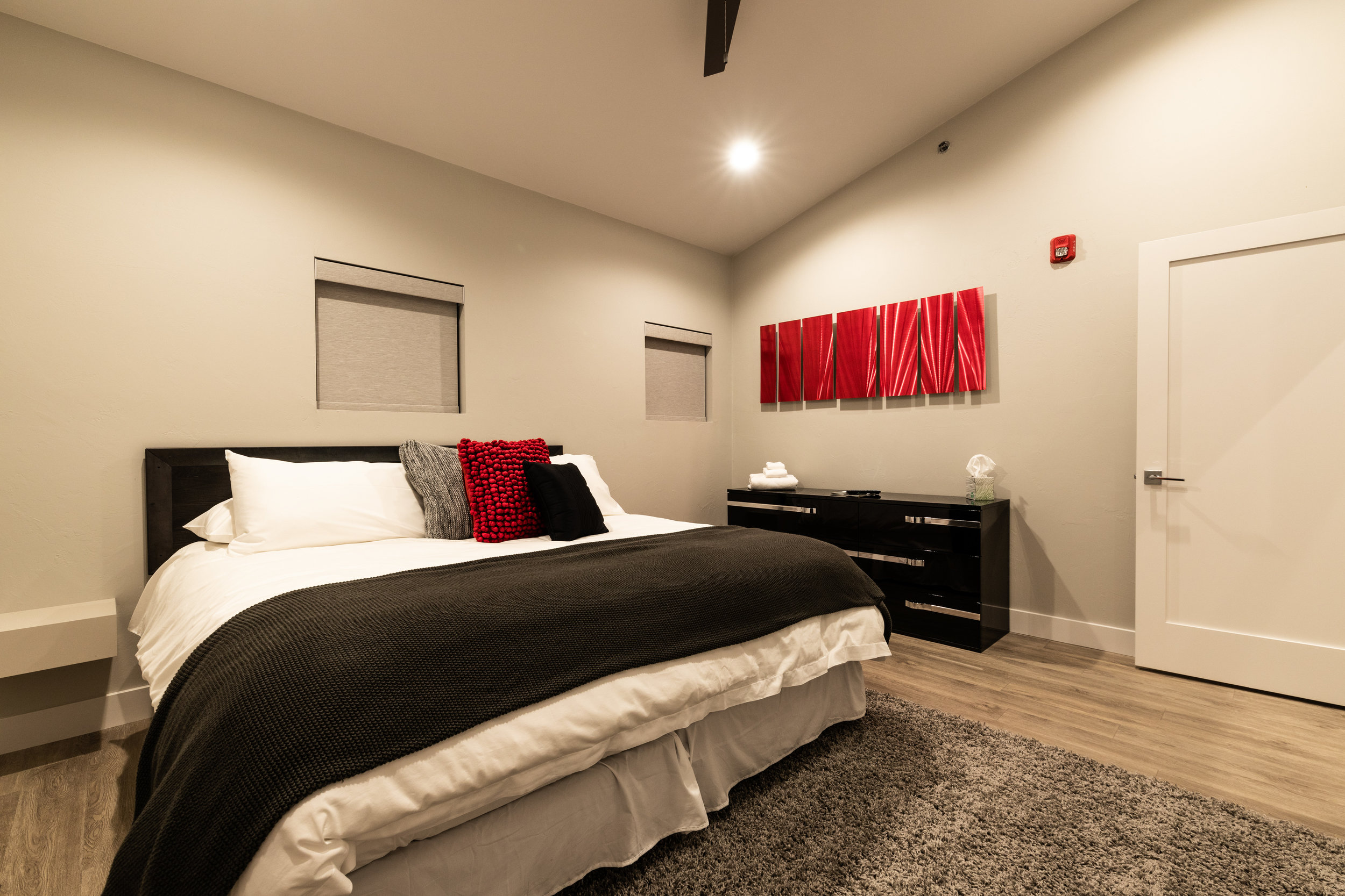 Monte Carlo's guest bedroom in radiant red is just the space your guests want.