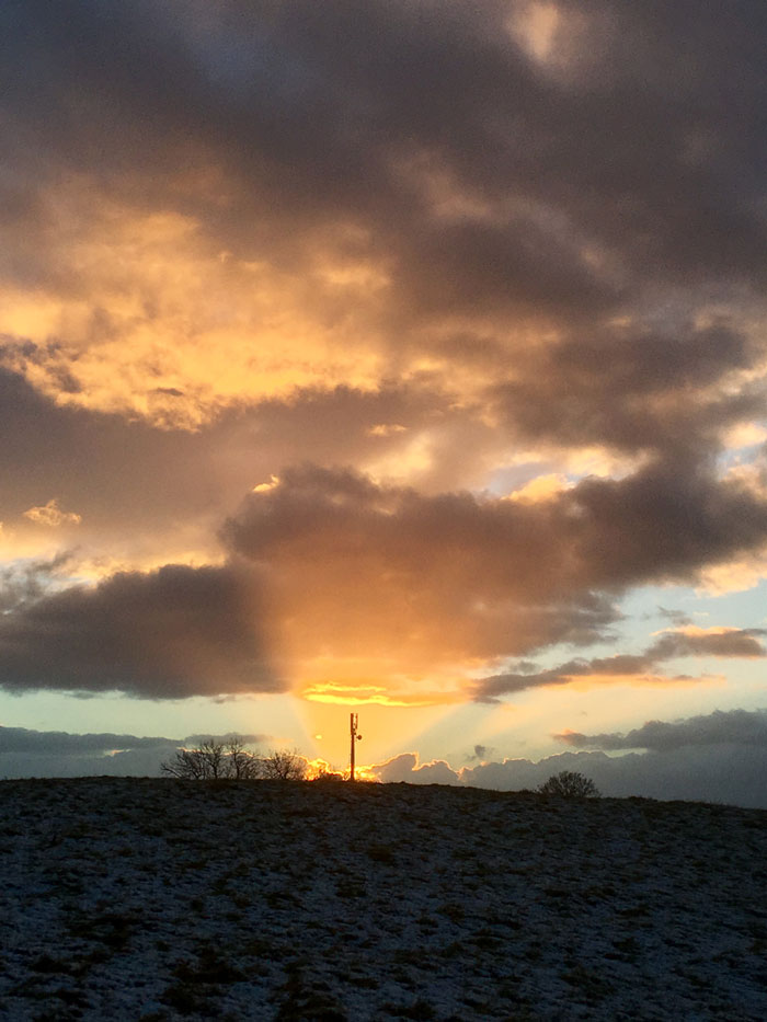 The EE mobile mast near Drovers Retreat in shaft of sunset light