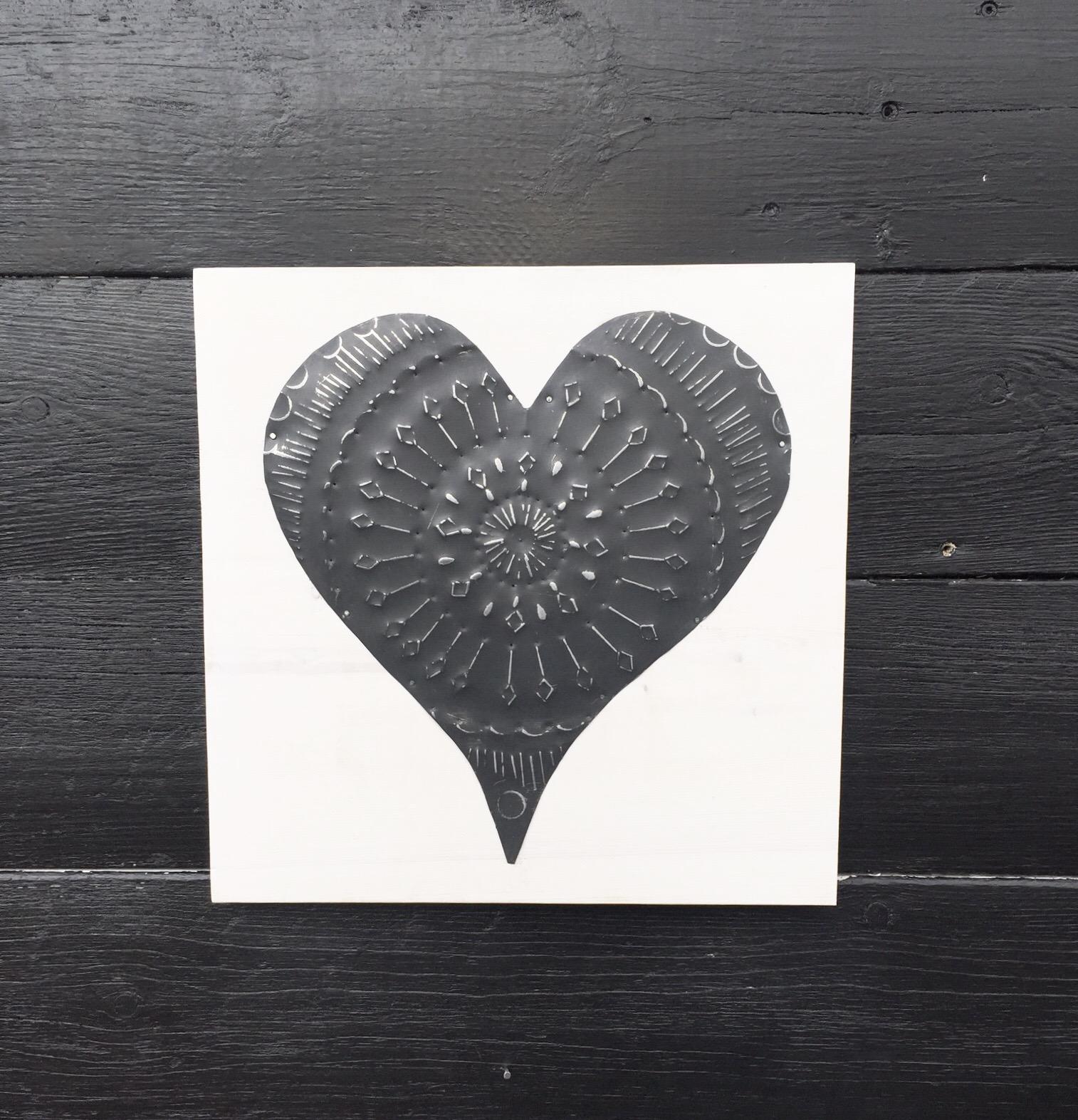 Black Mandala tin on white board