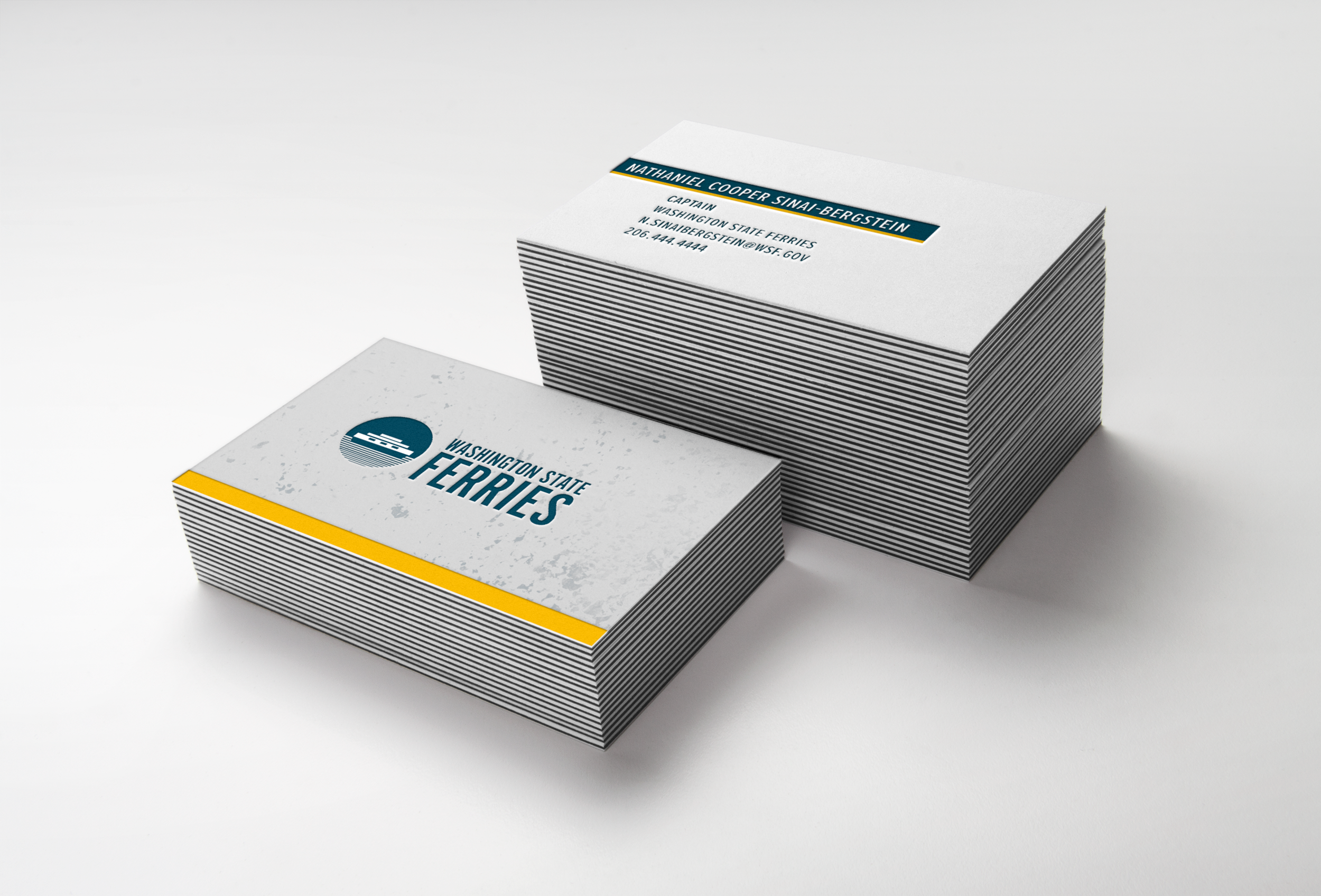 Business cards employ the subtle chipped white metal background and strong brand colors.