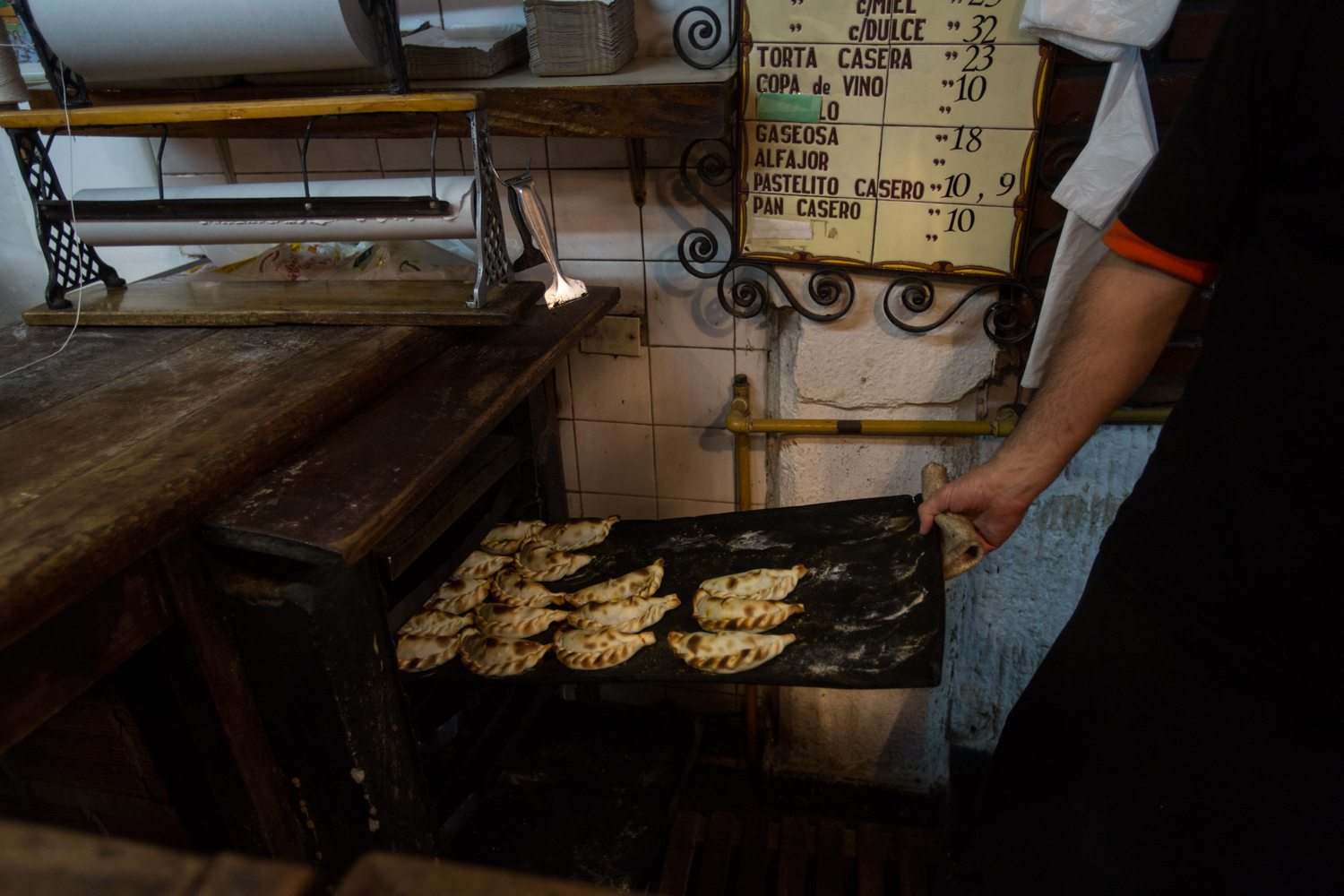 Empanadas are made in the back and then kept warm in this old oven.