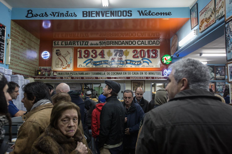 El Cuartito's crowded entryway.