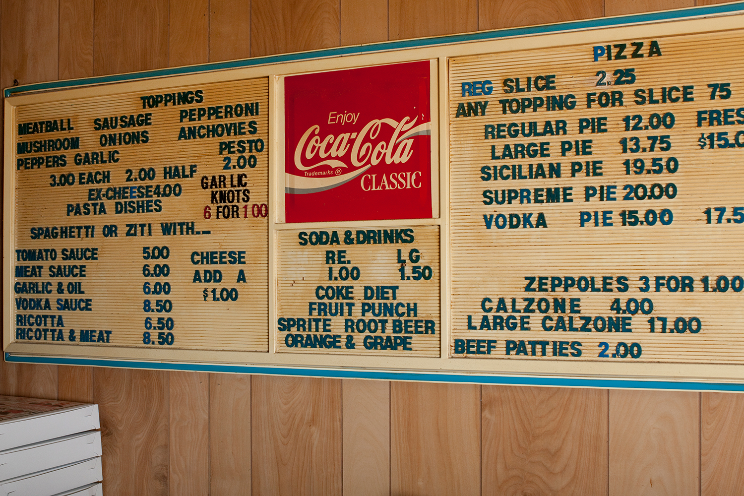 Luigi's replaced this menu sign a couple years ago but has not raised prices.