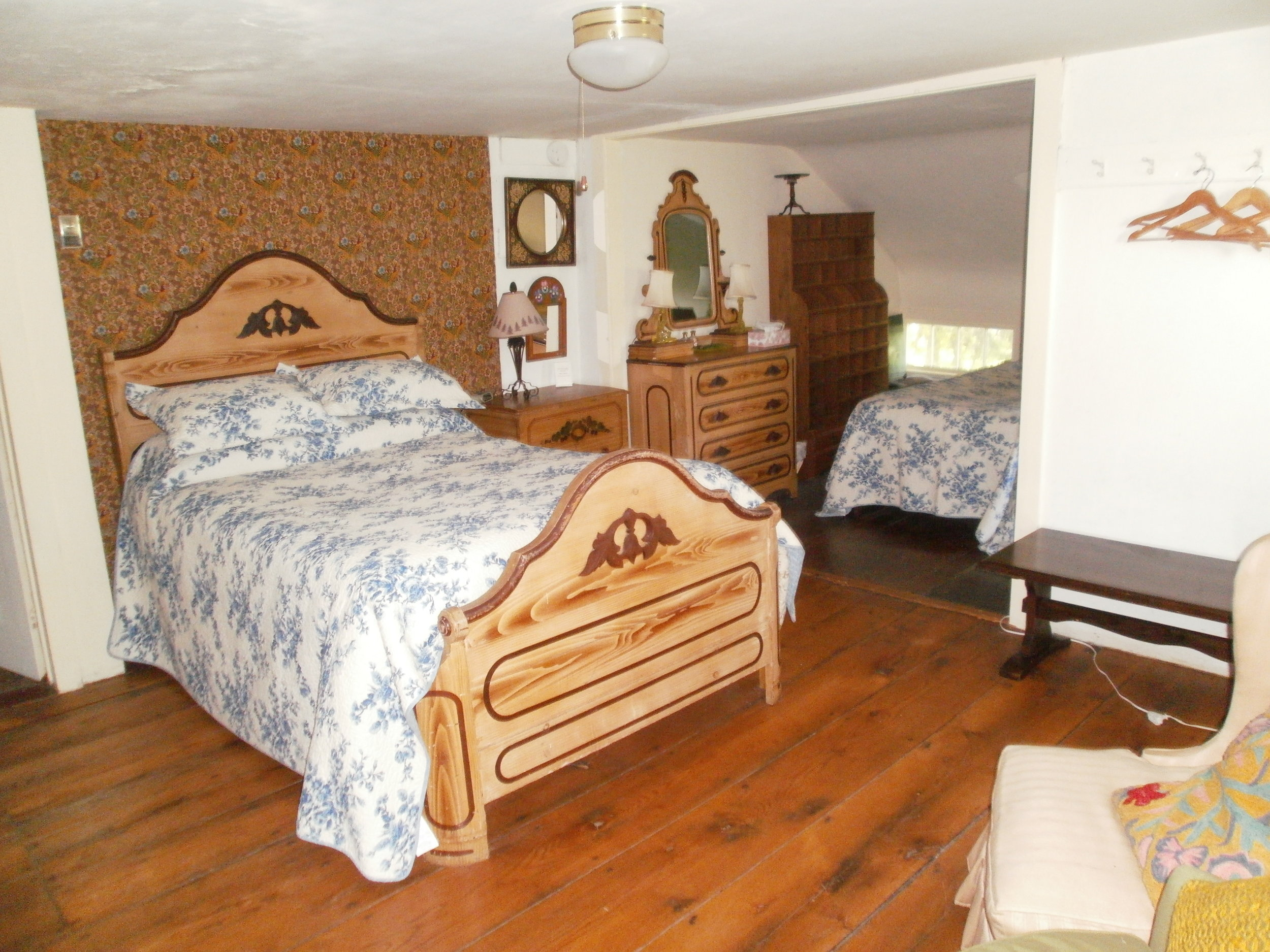 One of these rooms has a double bed and two twin beds, making it ideal for a family to share.