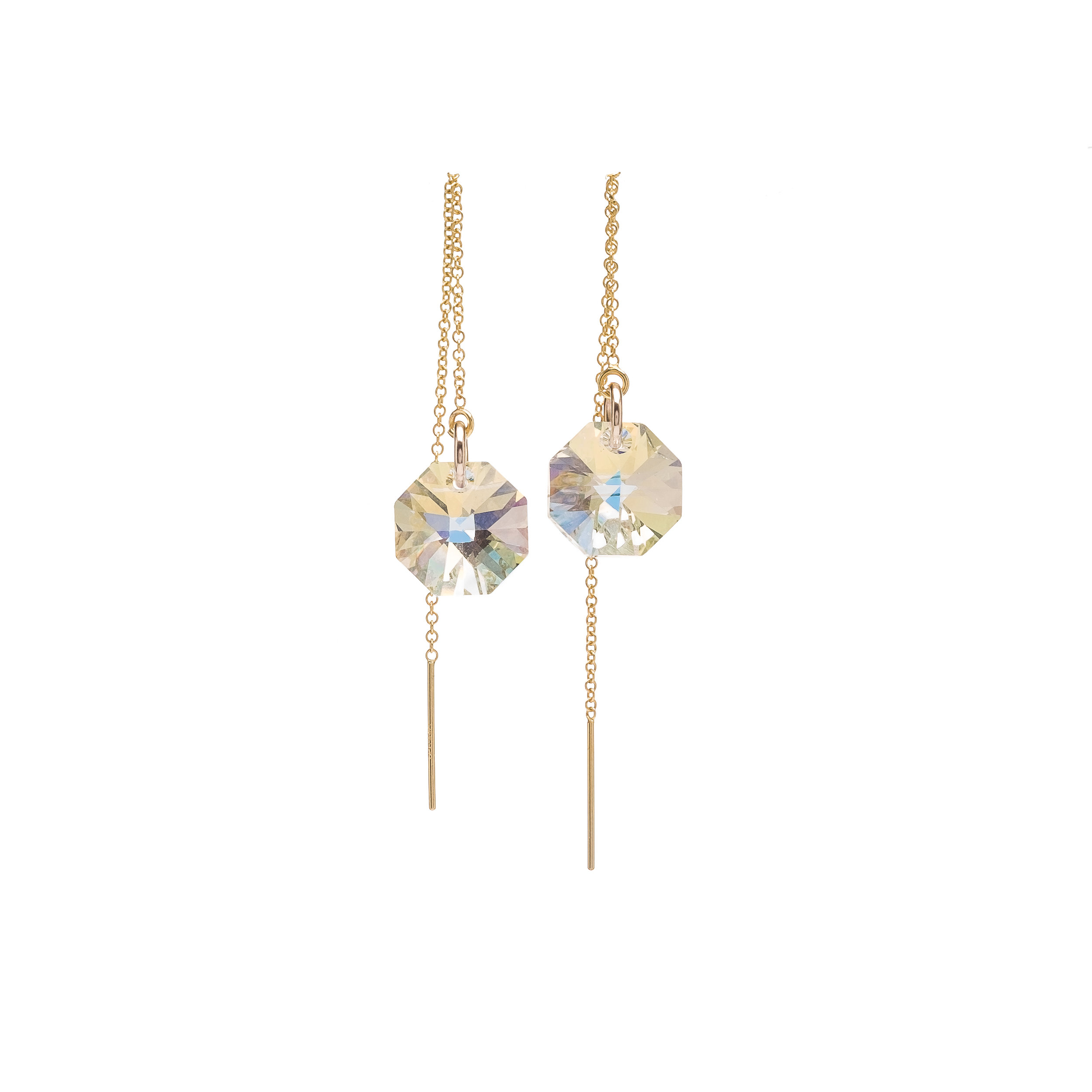 Octagon Swarovski Crystal Threaders - $65 Embrace your individual side with these Holiday Threader earrings. These earrings are great for a quirky yet classy look that's sure to dazzle.