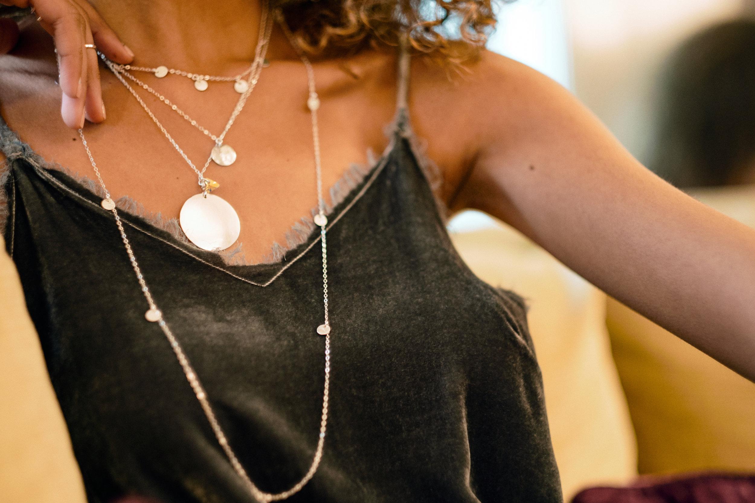 Model wears  Talia Single Disc Necklace ,  Talia 5 Disc Necklace ,  Talia 10 Disc Necklace , and the  Medallion Necklace .
