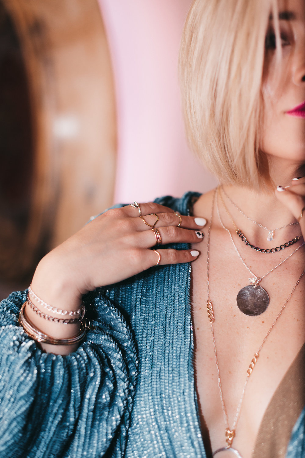 Megan wears the Tiny Dancer,  the Gwen , the Medallion, and  the Stevie . Bracelets:  The Toggle  and the Bangle Bracelets. Rings: Bullet series, Hexagon, Stackable band and the Wave Band.
