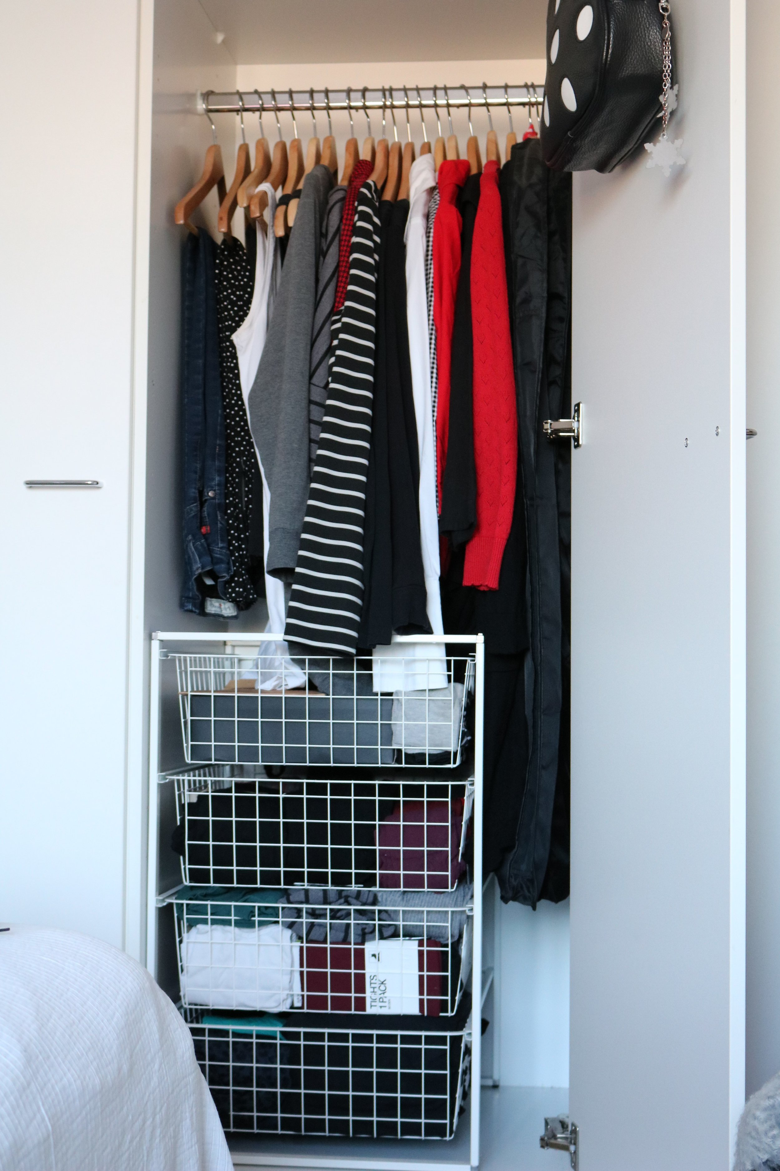 Everything in regular use, excluding shoes and outerwear, fits in the closet quite comfortably. I keep a few dresses in reserve inside the clothes covers on the right.