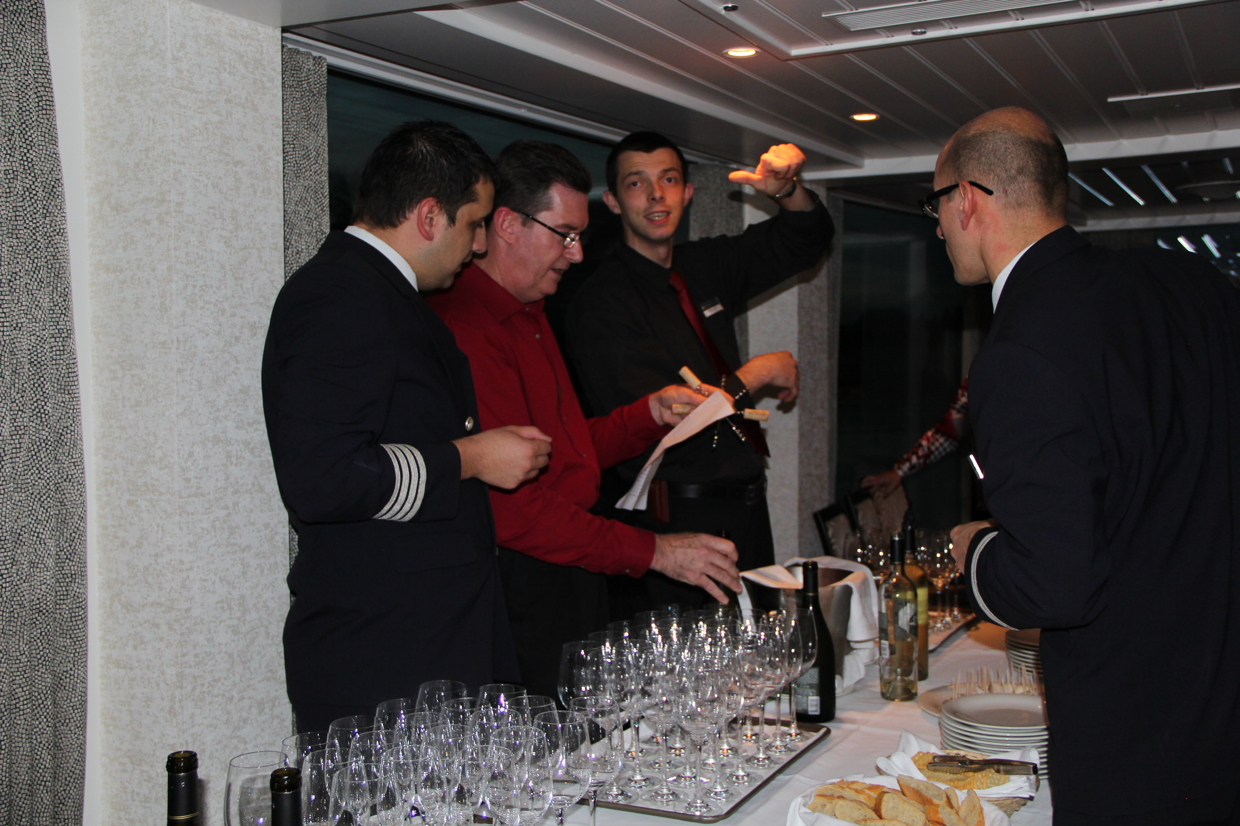 Mark (our friend & wine host) & crew prepare for a wine tasting on the AmaDagio 2014 on wine themed cruise