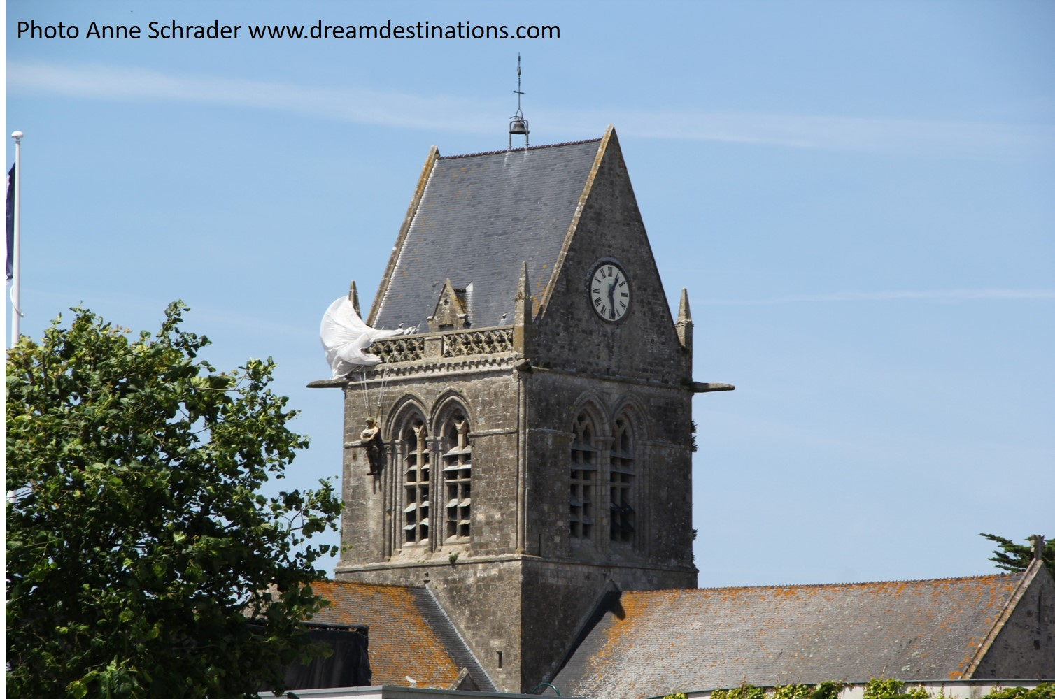 Ste. Mere Eglise church steeple with the replica of a dangling PFC John Steele