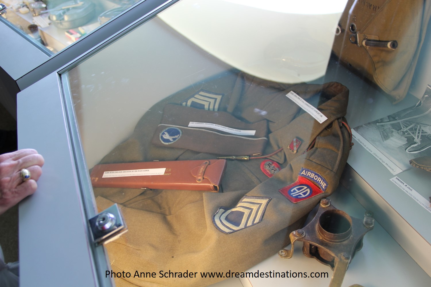 Sargeant's jacket and slide rule used during the glider operations displayed in the Airborne Museum, Ste. Mere Eglise