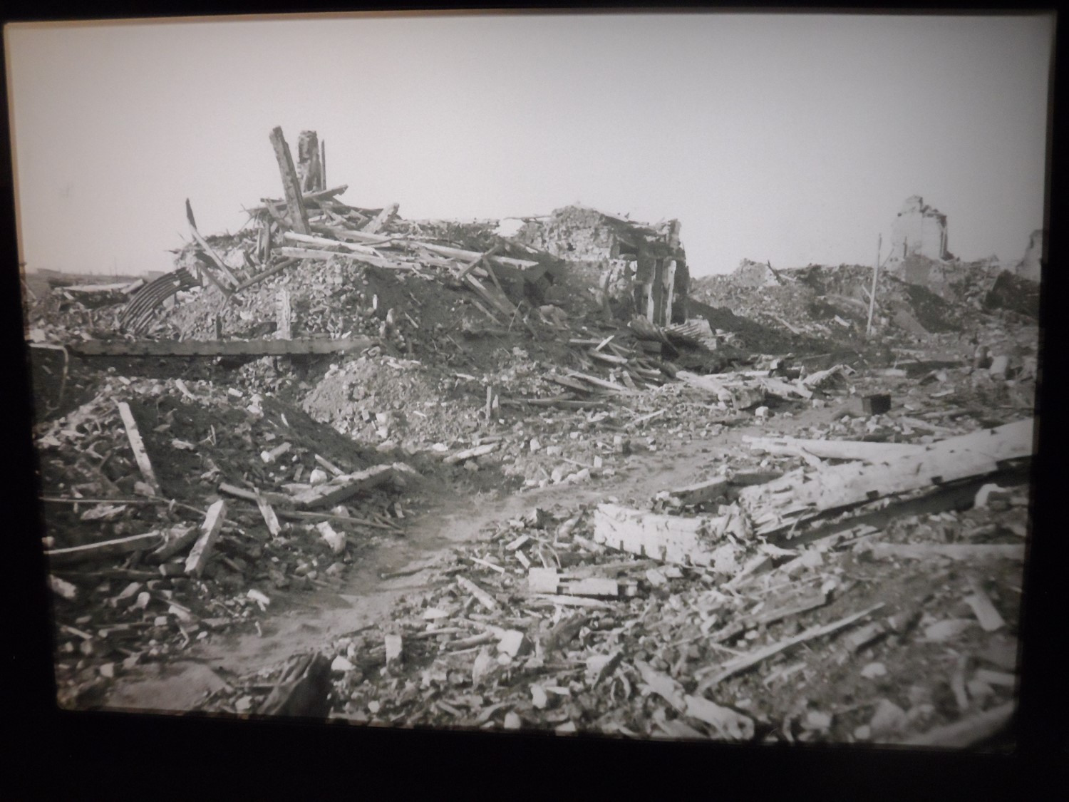 Some of the destruction caused by the war Photograph on display in the Tourist Information Center