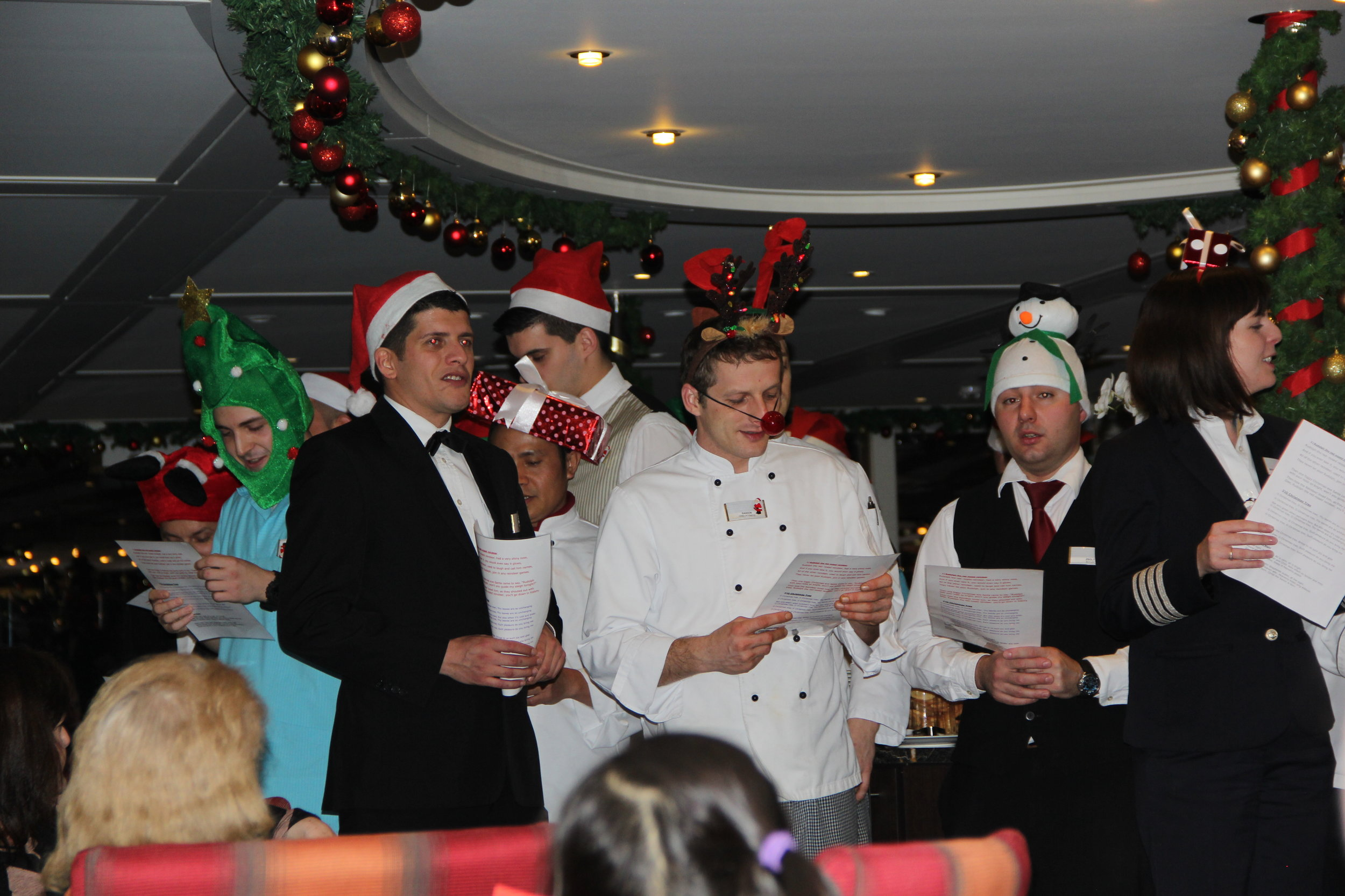 The crew sing Christmas Carols on the AmaCerto in 2015