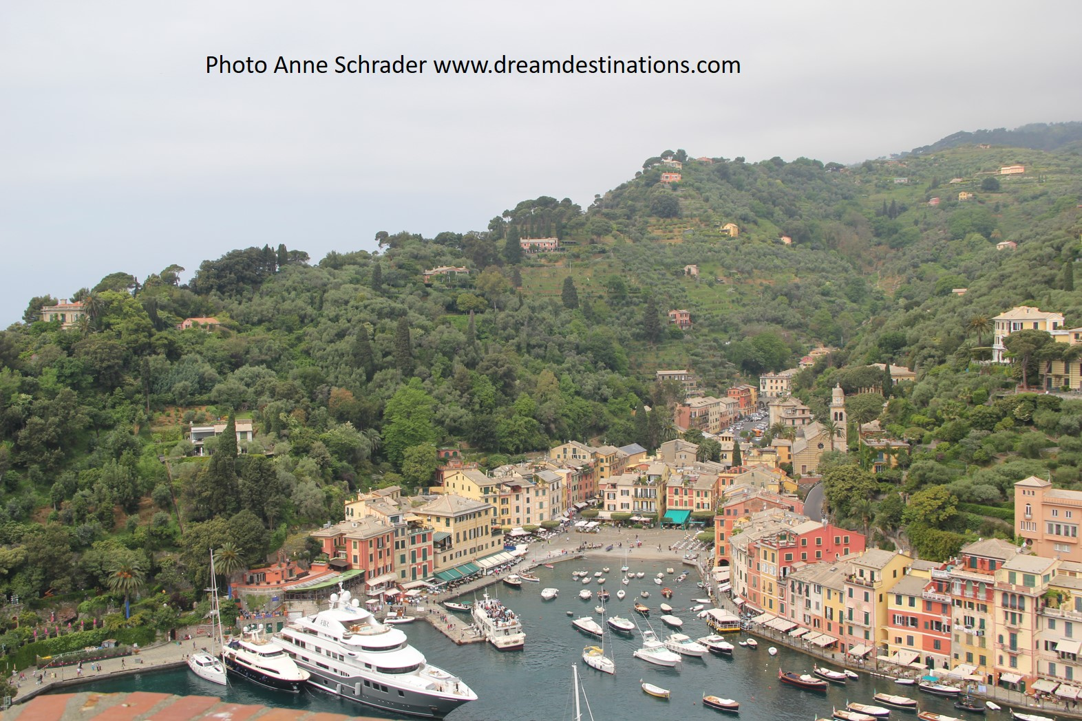 Color pops against the green trees in Portofino
