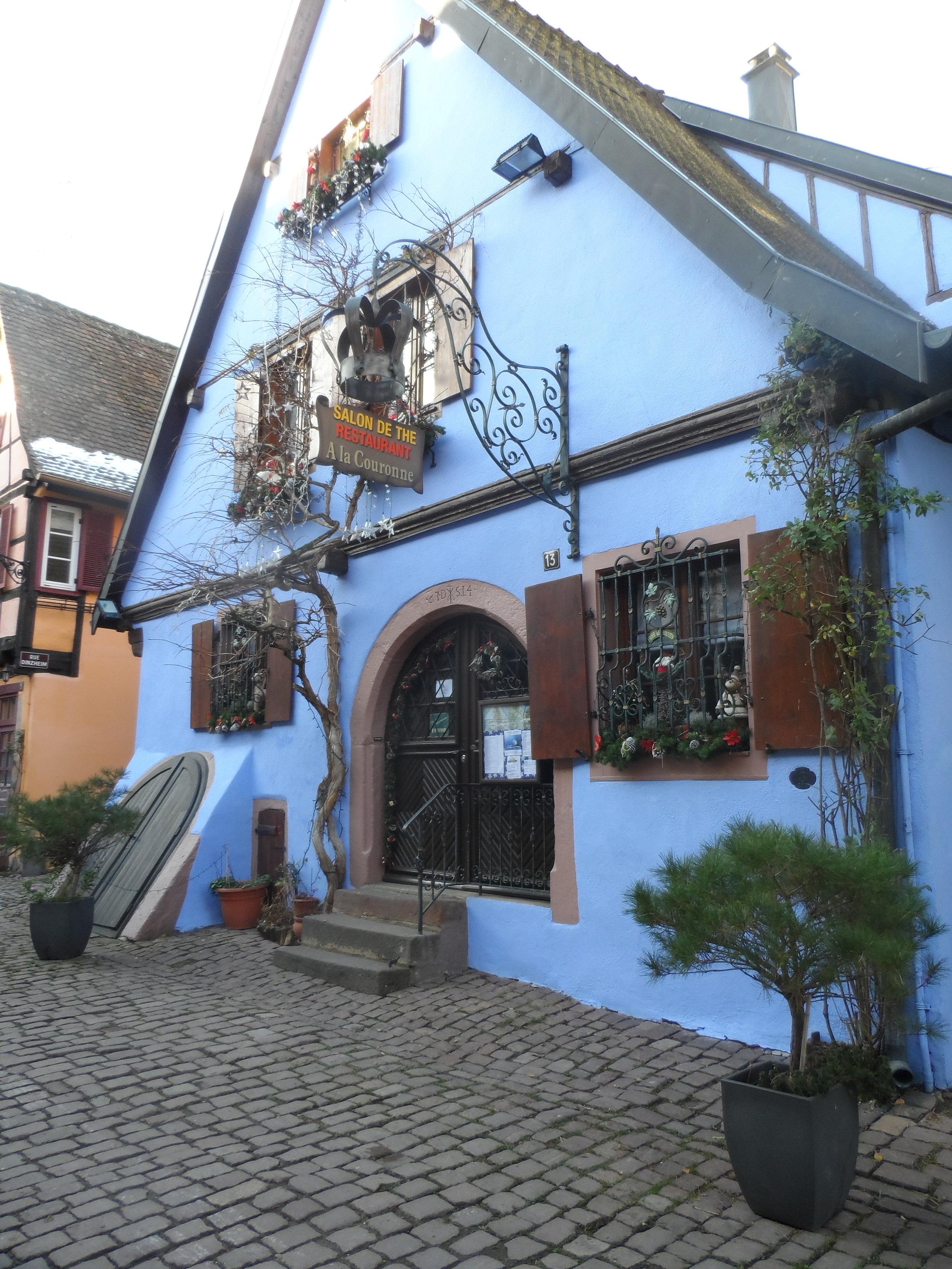 Brilliant, vivid blue colored building in Riquewhir