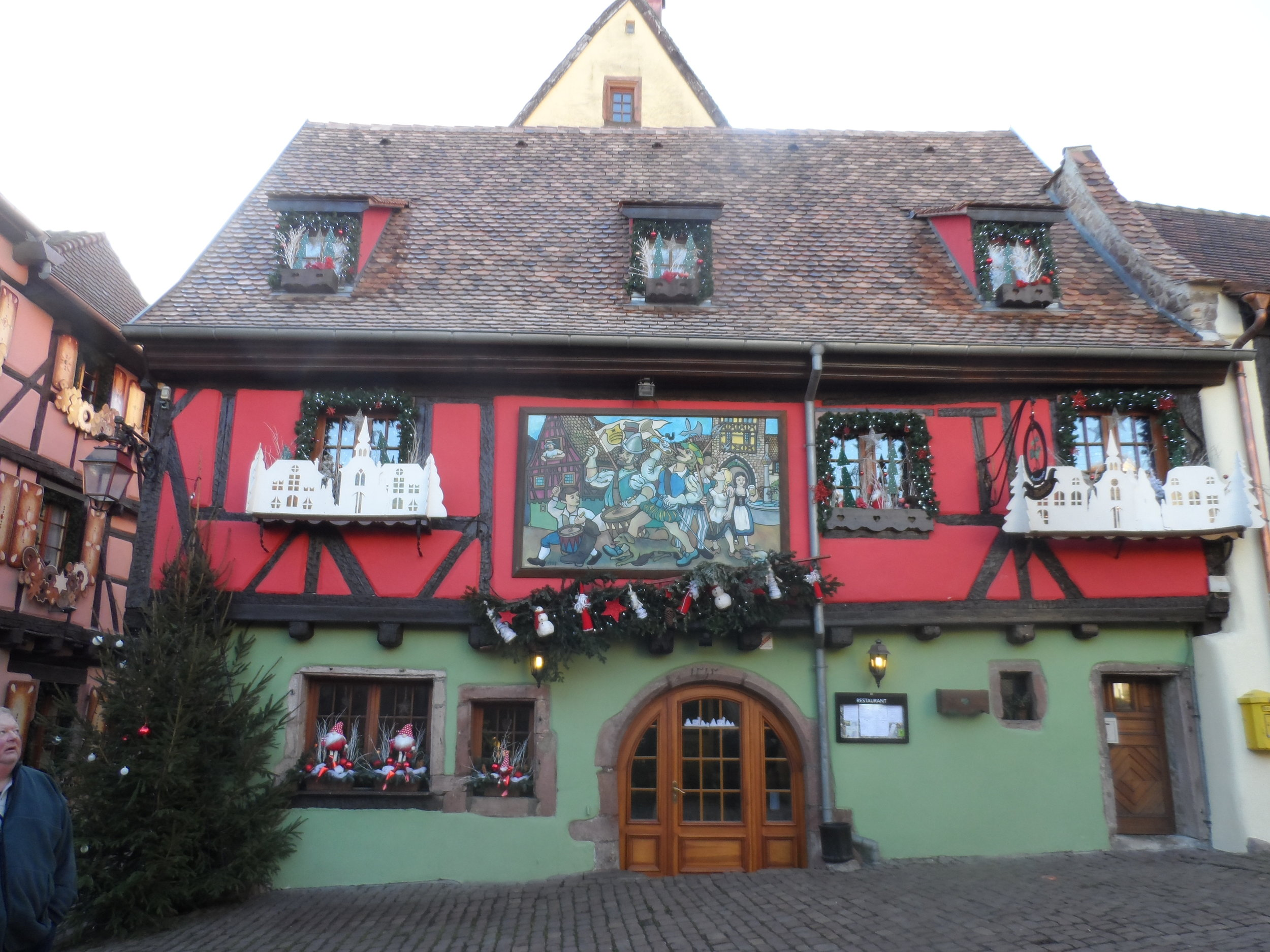 Red and green half timbered building in Riquewihr