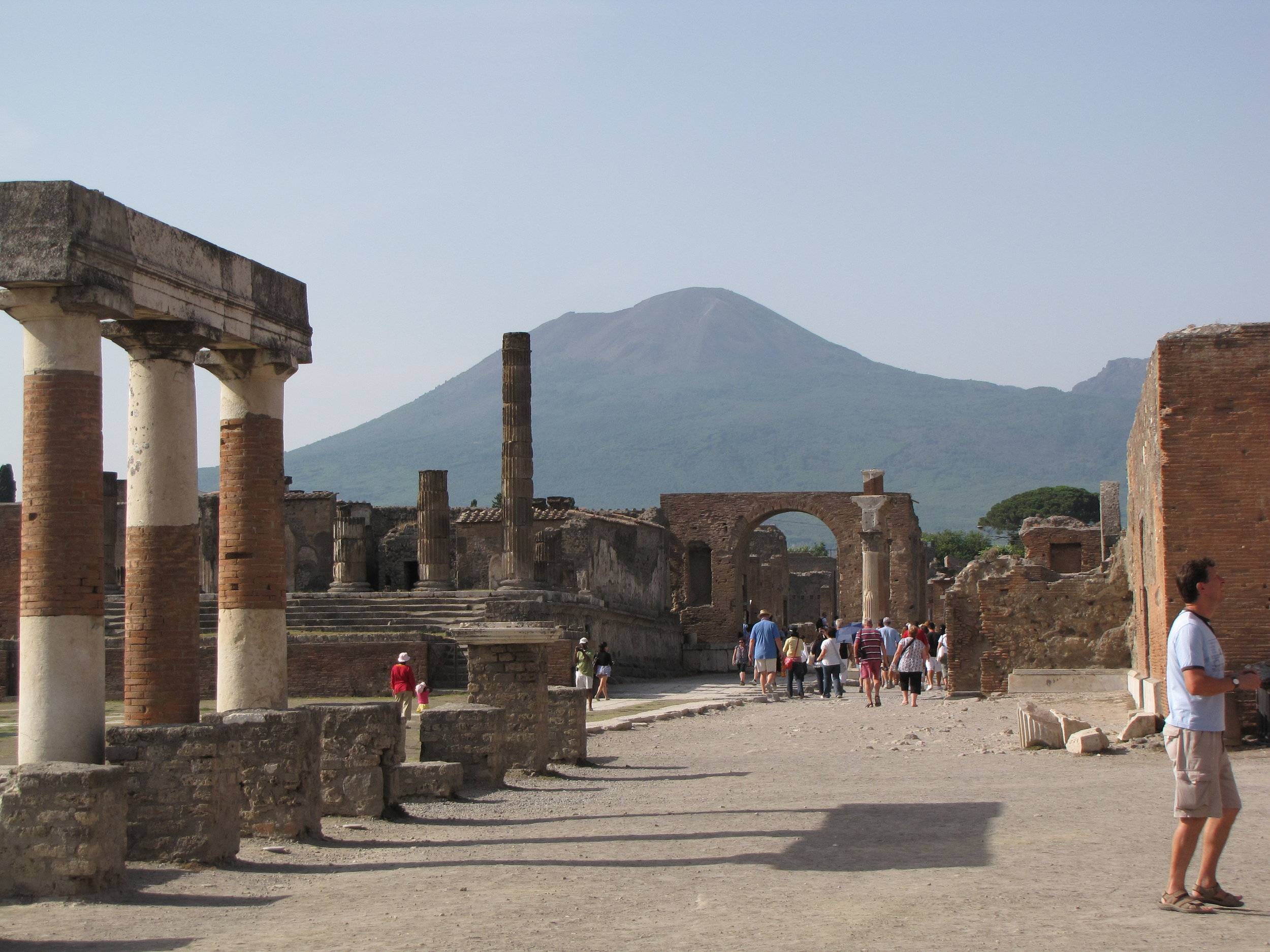Pompeii Forum. In the background is Mt Vesuvius, the volcano that erupted in 79 A.D and buried the entire town in 30 feet of hot volcanic ash.