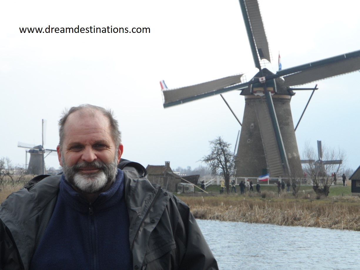 Hank at the windmills in Kinderdijk on a chilly Spring Day—never let the weather deter your trip!