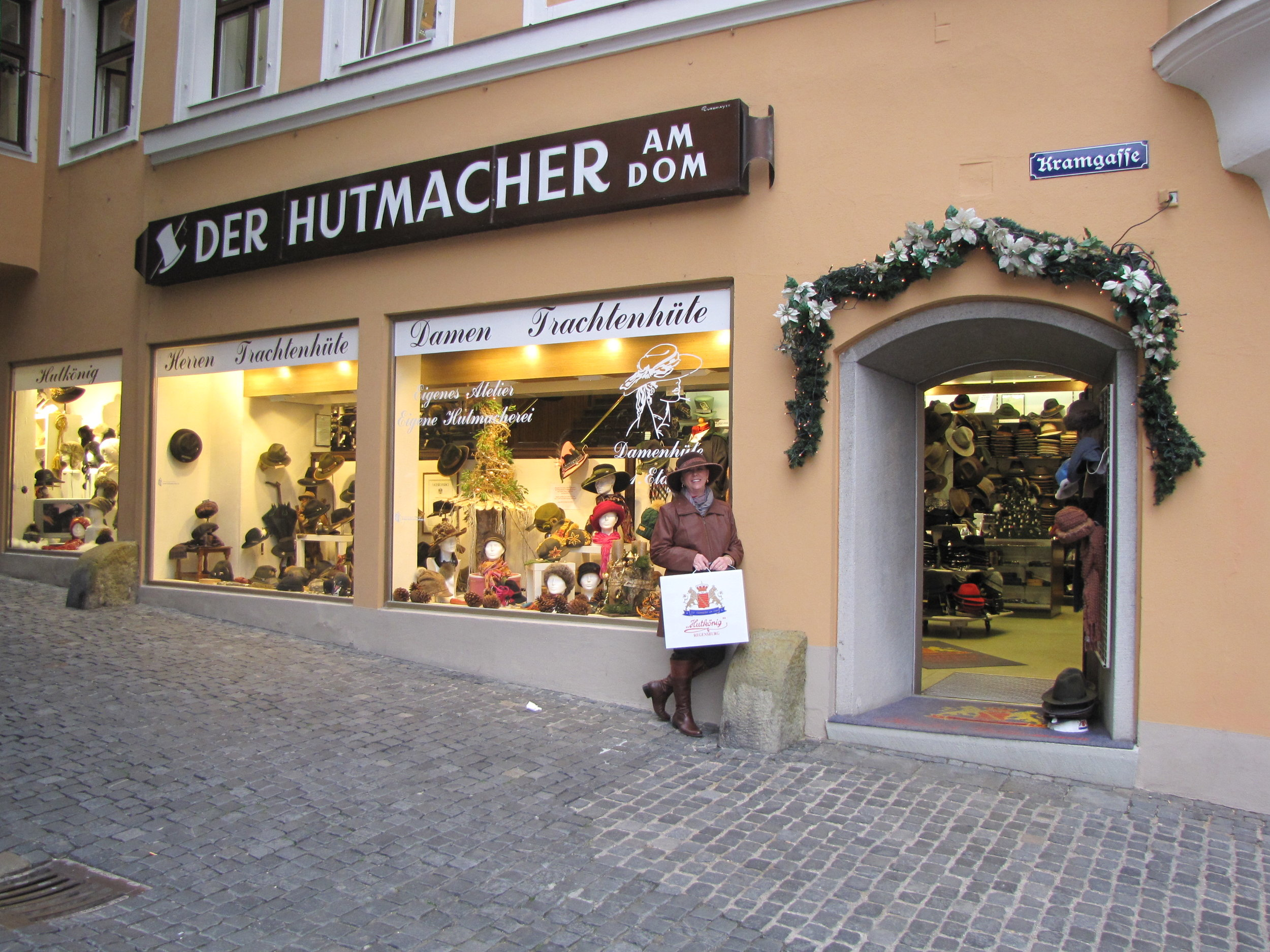 Anne wearing her new hat outside the Hat King Store in Regensburg, Germany
