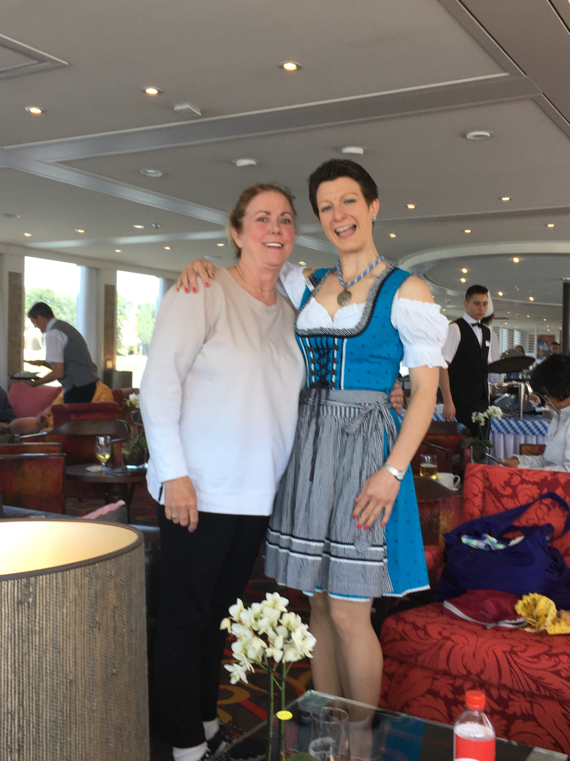 Anne with Jess at German food party while sailing—see the hard working crew in the background?
