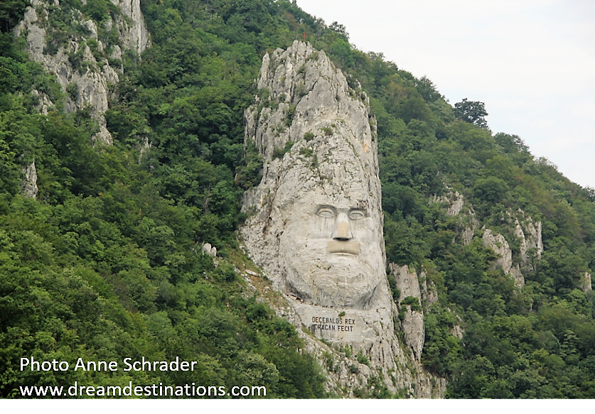 Iron Gates on a Lower Danube Cruise—Decebalus (the last king of Dacis, who fought against the Roman emperors Domitian & Trajan to preserve the independence of his country, which corresponded to modern Romania) gazes at passengers as they cruise the Iron Gates.
