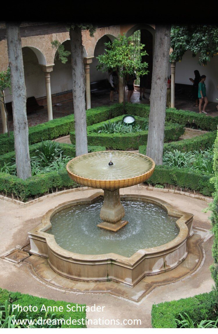 A tranquil garden fountain in the Nazaries Palace in the Alhambra