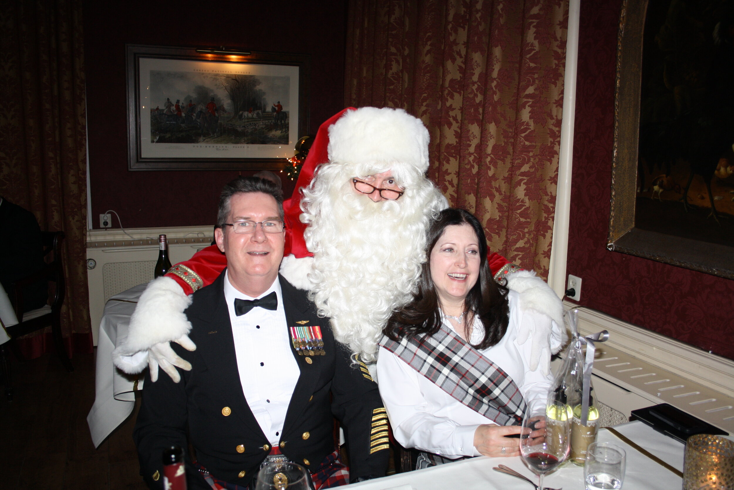 Mark and Denise Thomas with Santa Claus for Christmas Even Dinner—he greeted the waitstaff in Dutch!