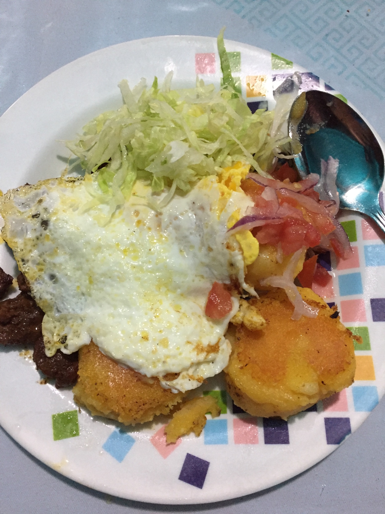 My dinner. Beef with fried smashed potatoes, red onion and tomato salad, and a fried egg.