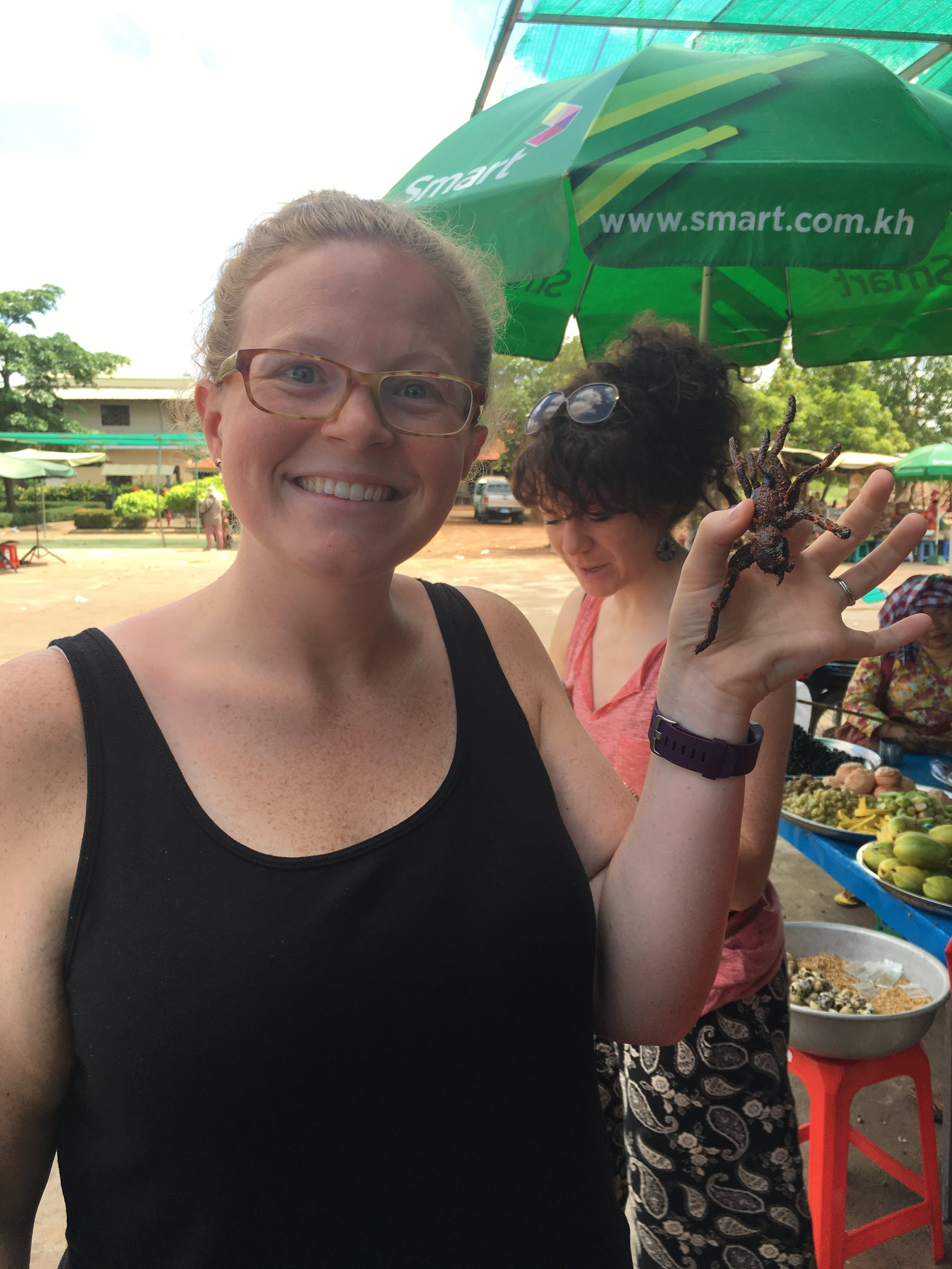 Travel makes you do weird things like: eat tarantula in Vietnam. Also, I really like posing with my food.
