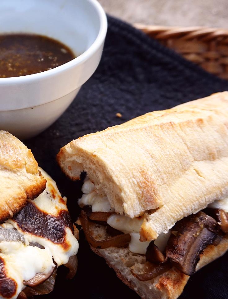 Vegan portobello mushroom french dip sandwiches with vegan au jus and onion.