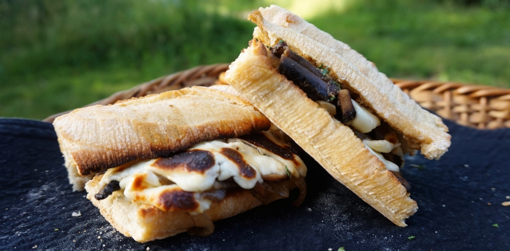 Vegan french dip sandwiches with vegan au jus and onion.