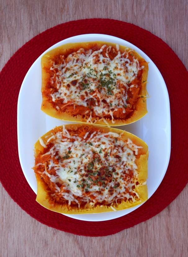 Baked spaghetti squash with marinara, vegan mozzarella, and parsley.