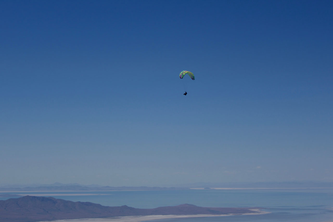 "Calef soaring above the ""V"" launch with the Great Salt Lake in the distance, photo Ryan Dunn."