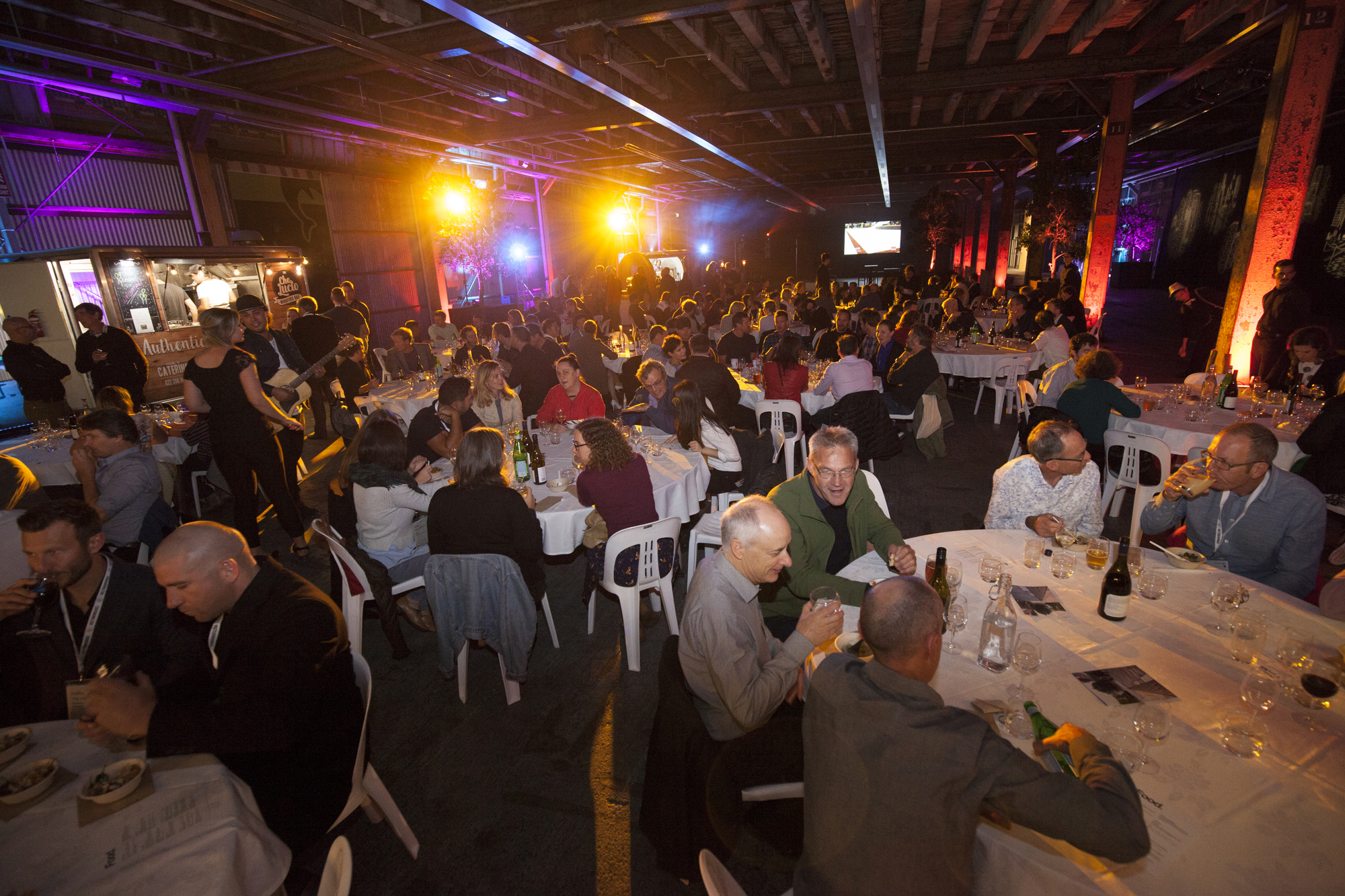 Conference dinner held at Shed 10 - with food trucks and street entertainment bringing the big space to life.