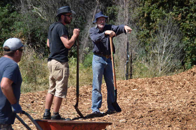 Mike Barthelmeh and his students working on a community project - spreading mulch and weeding in Christchurch-east.
