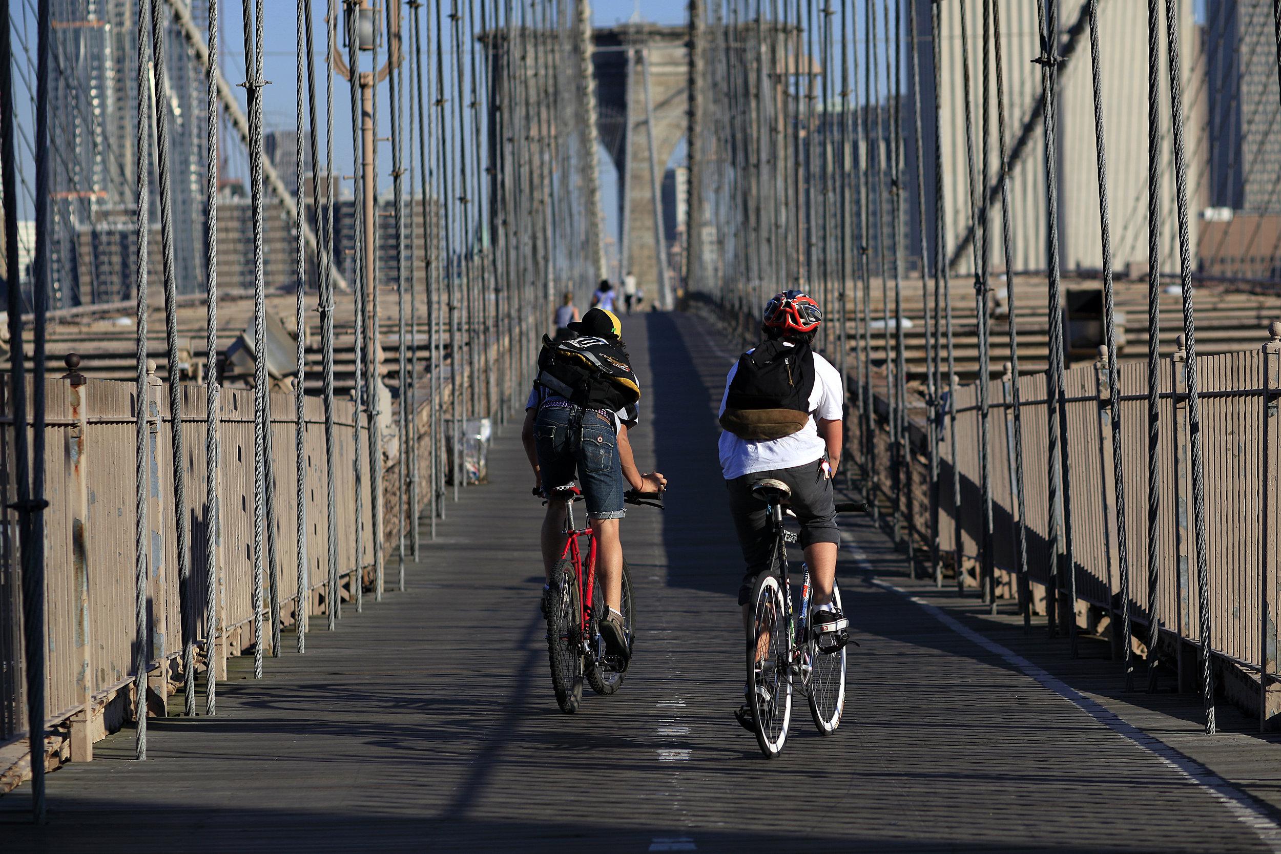Cyclng on Brooklyn Bridge, NYC. Photo credit - NYC & Company, Joe Buglewicz.