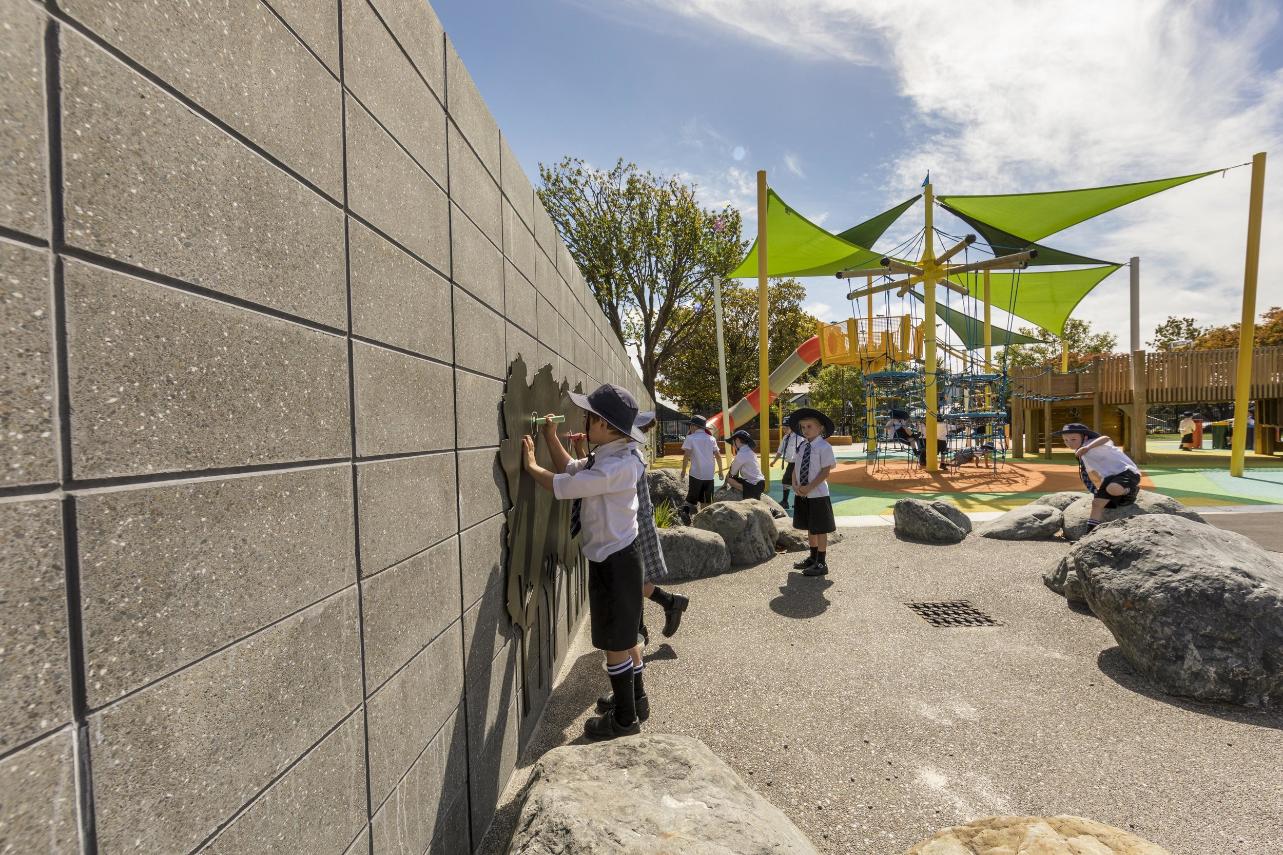 """The two metre boundary wall is crammed with """"play value"""" features, and was built using Firth's honed blocks from their Architectural 20 series."""