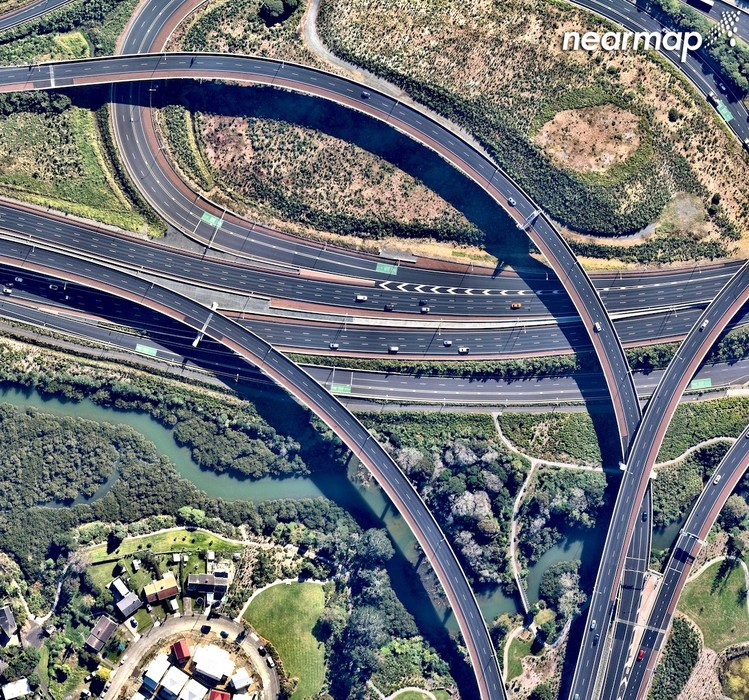 Nearmap offers measurement tools and NZ specific data.