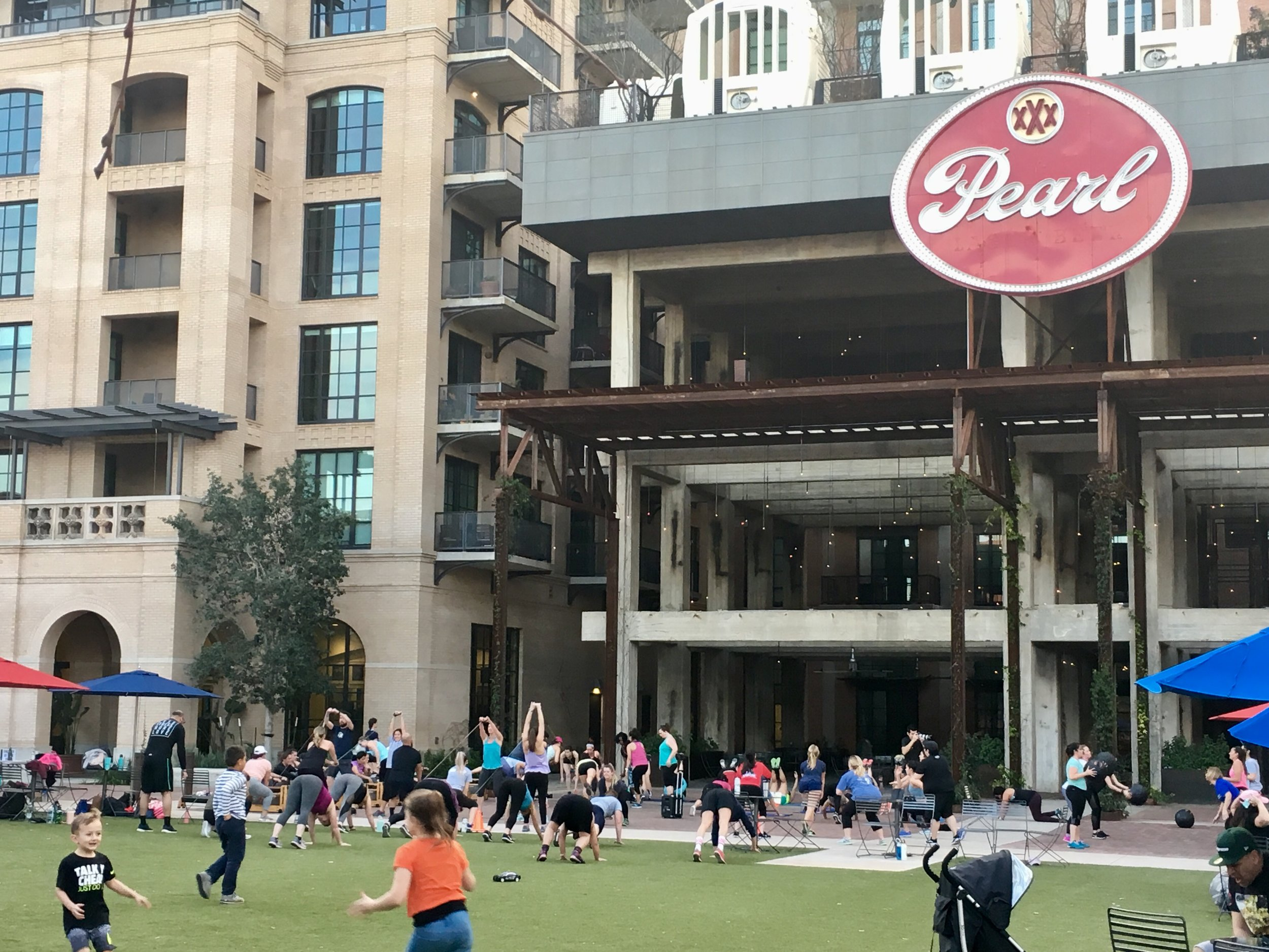 The Pearl Brewery open space provides space for a group exercise class.