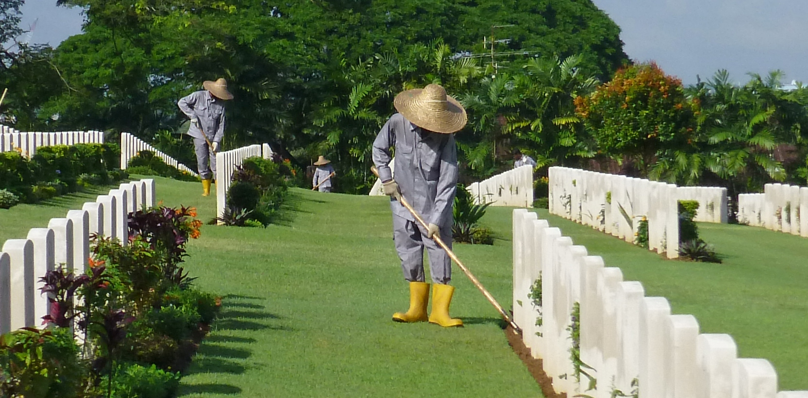 Gardeners tend graves at Kranji cemetery in Singapore. Photo credit: Commonwealth War Graves Commission